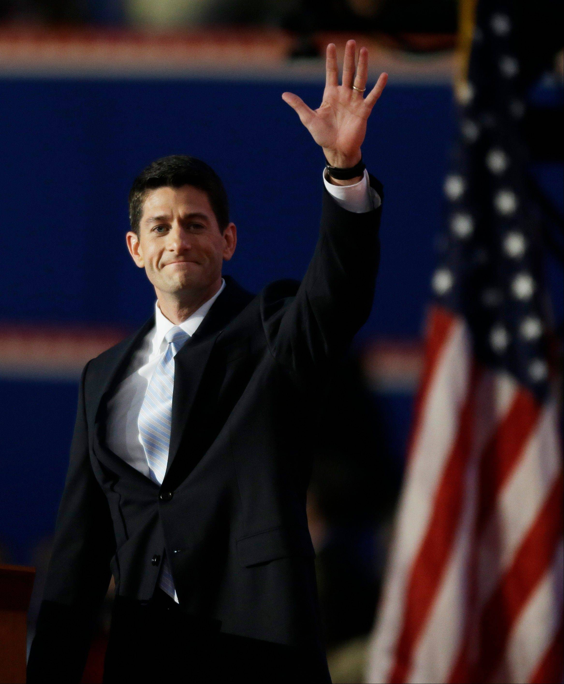 Republican vice presidential nominee, Rep. Paul Ryan waves as he arrives to address the Republican National Convention in Tampa, Fla., on Wednesday, Aug. 29, 2012.