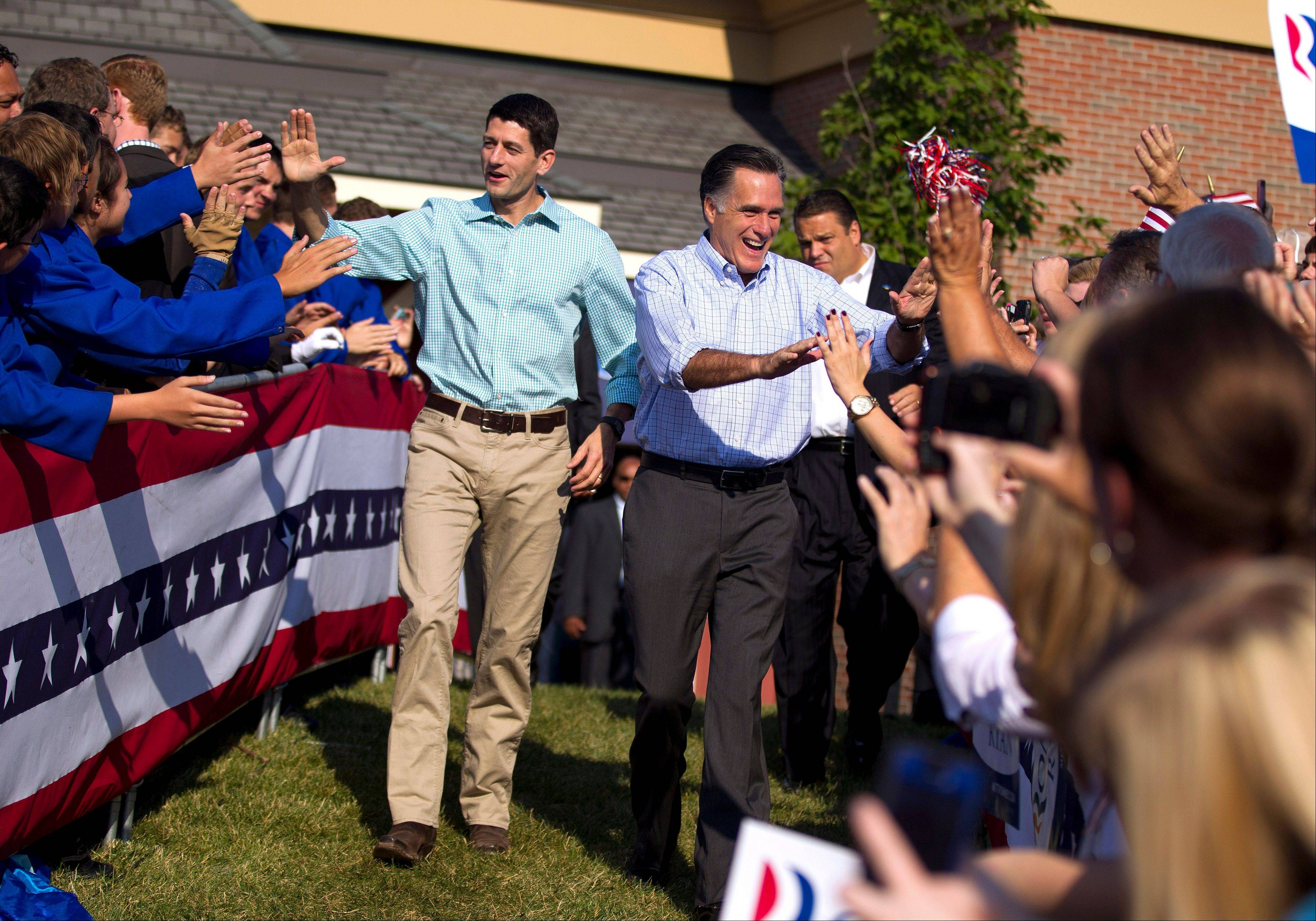 In this Aug. 25, 2012 file photo, Republican presidential candidate, former Massachusetts Gov. Mitt Romney and his vice presidential running mate Rep. Paul Ryan, arrive for a campaign rally in Powell, Ohio. They're the political world's newest odd couple: Mitt Romney and Paul Ryan are bound by substance, but dramatically different in style.