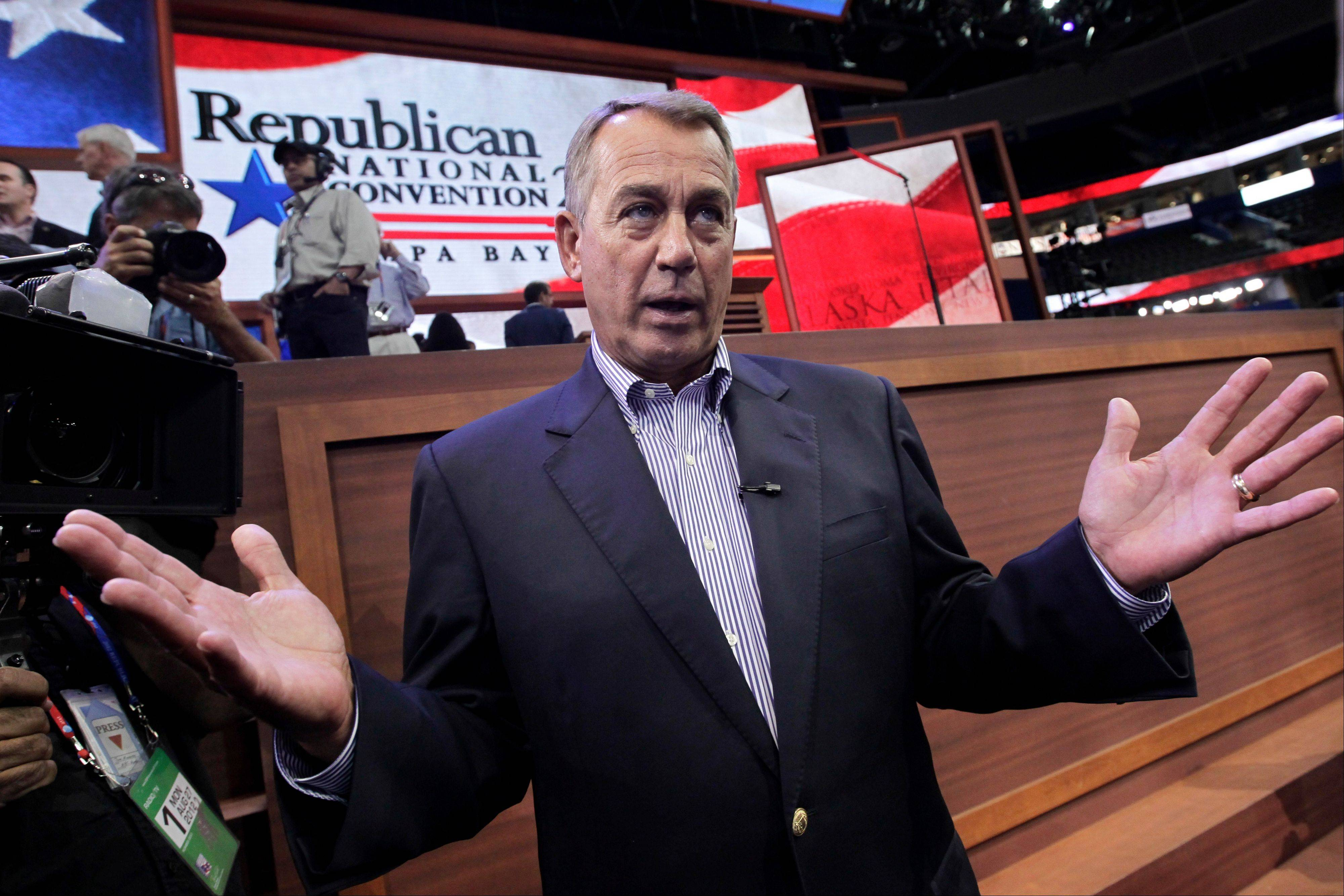 @captioncredit:Associated Press House Speaker John Boehner of Ohio talks to reporters on the floor of the Republican National Convention in the Tampa Bay Times Forum in Tampa, Fla. He spoke to Illinois delegates at their hotel Wednesday.