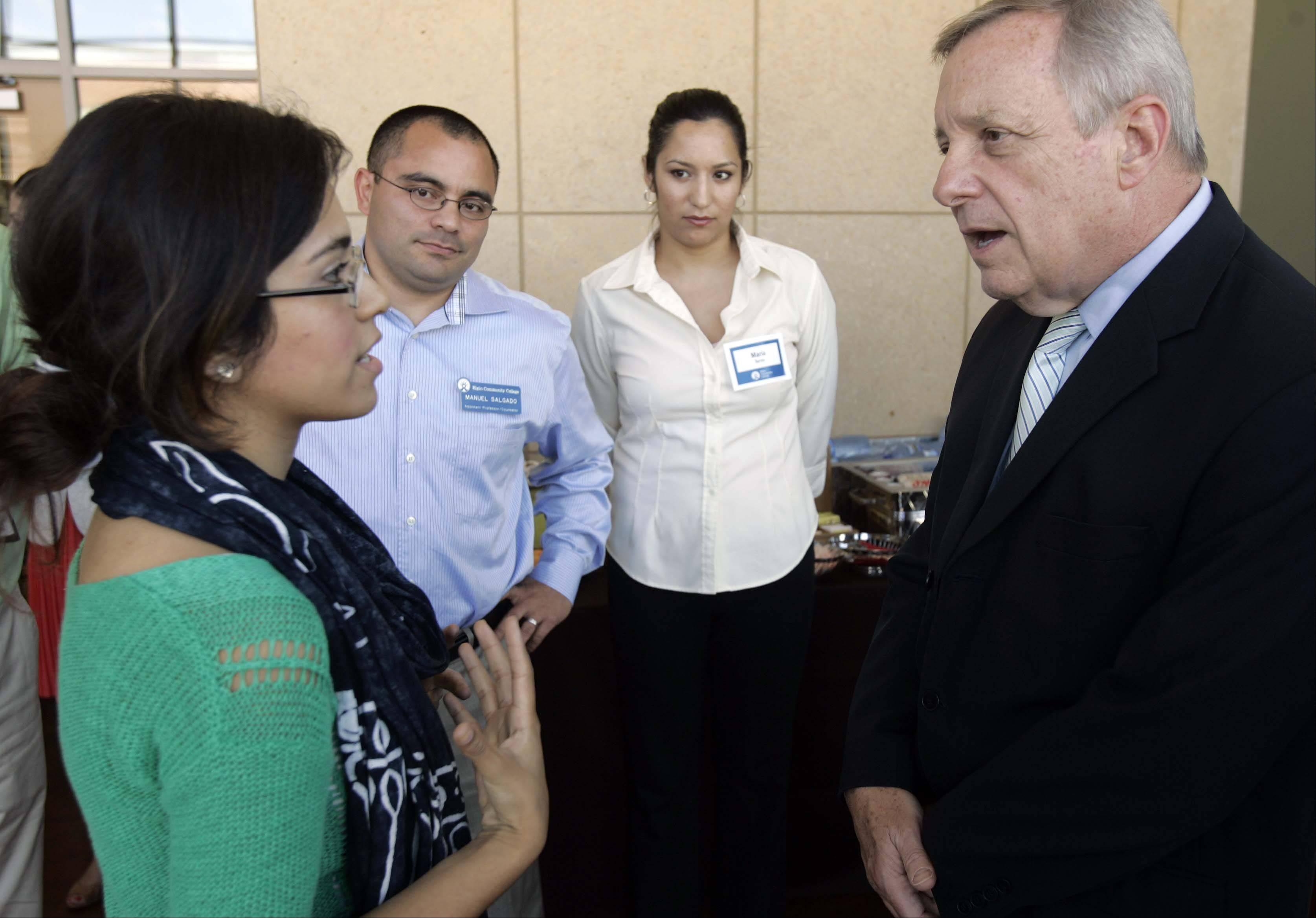 Sen. Dick Durbin, right, talks with Elgin Community College student Stephanie Salas of Elgin during his visit Tuesday to Elgin Community College.