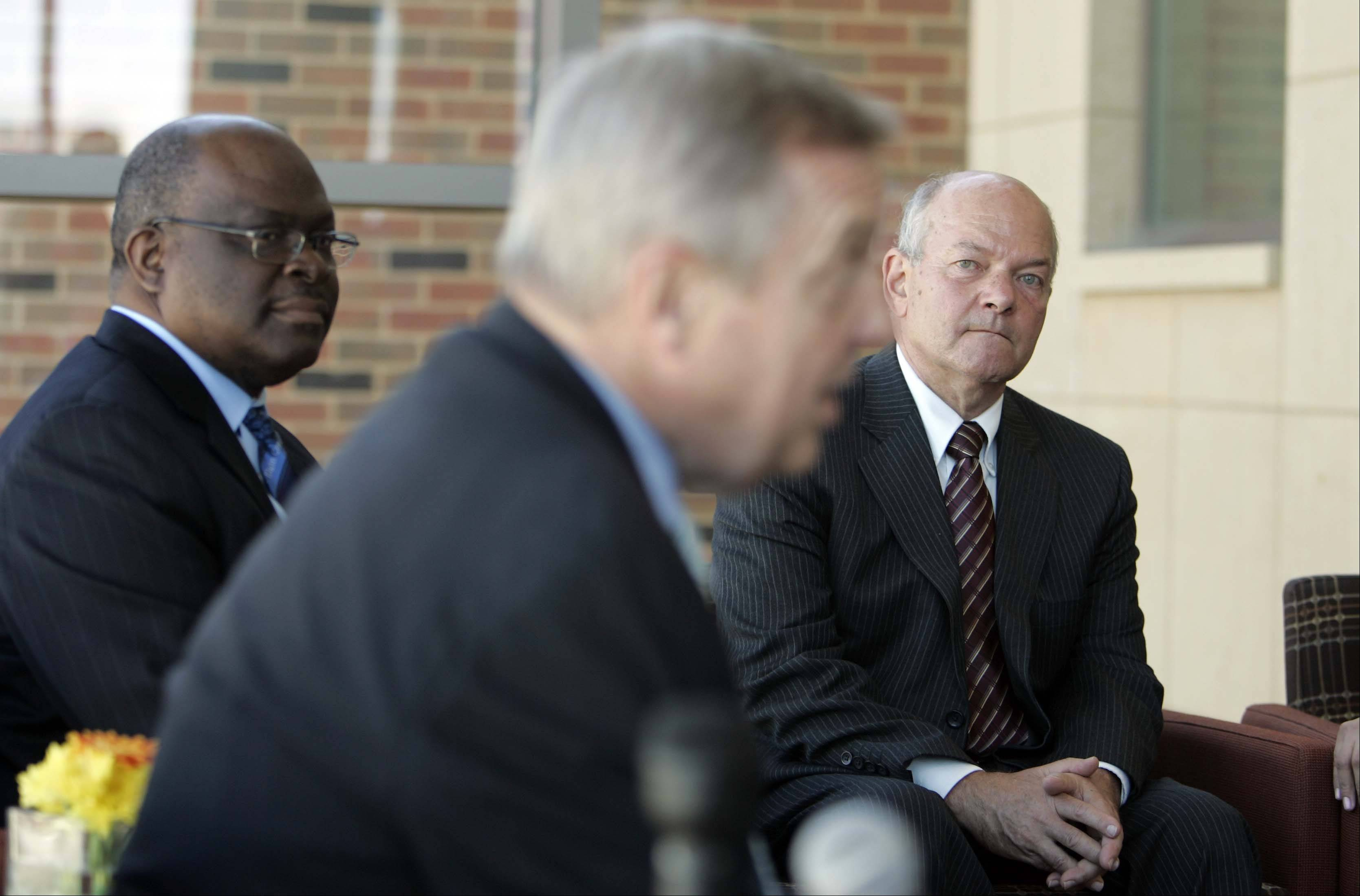 Elgin Community College President David Sam, left, and Elgin Mayor David Kaptain, right, listen as Sen. Dick Durbin, center, talks Tuesday about President Obama's deferred action policy, which is based on Durbin's DREAM Act at, Elgin Community College.