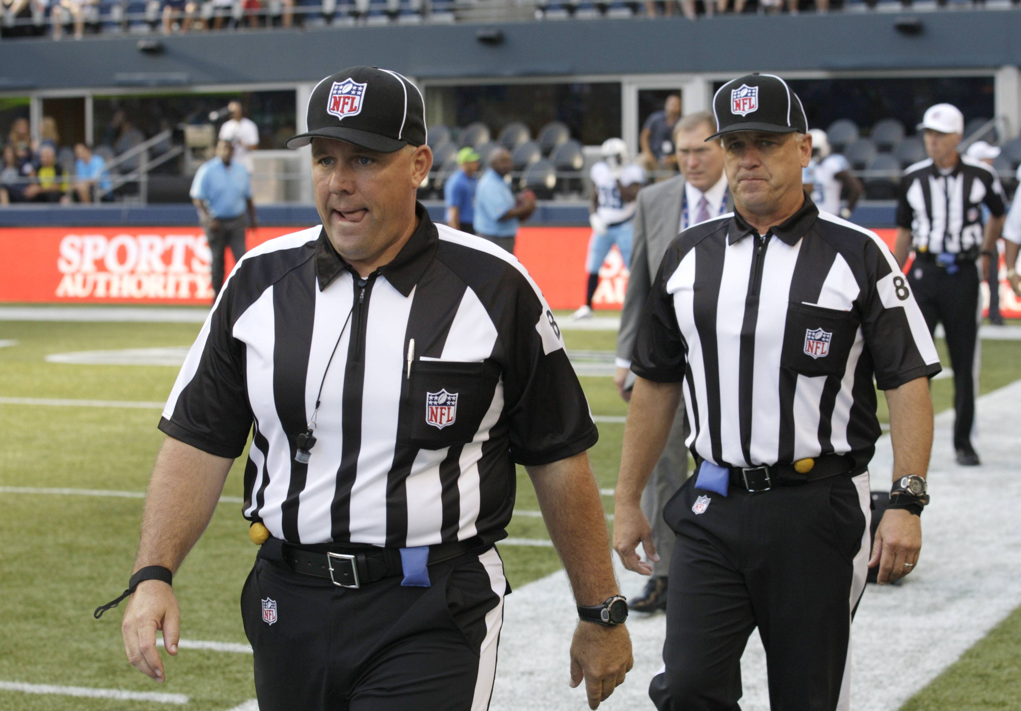 Replacement officials taking the field at the start of a preseason game between the Seattle Seahawks and the Tennessee Titans, in Seattle. The NFL will open the regular season with replacement officials. League executive Ray Anderson has told the 32 teams that with negotiations remaining at a standstill between the NFL and the officials' union. The replacements will be on the field beginning next Wednesday night, when the Cowboys visit the Giants to open the season.