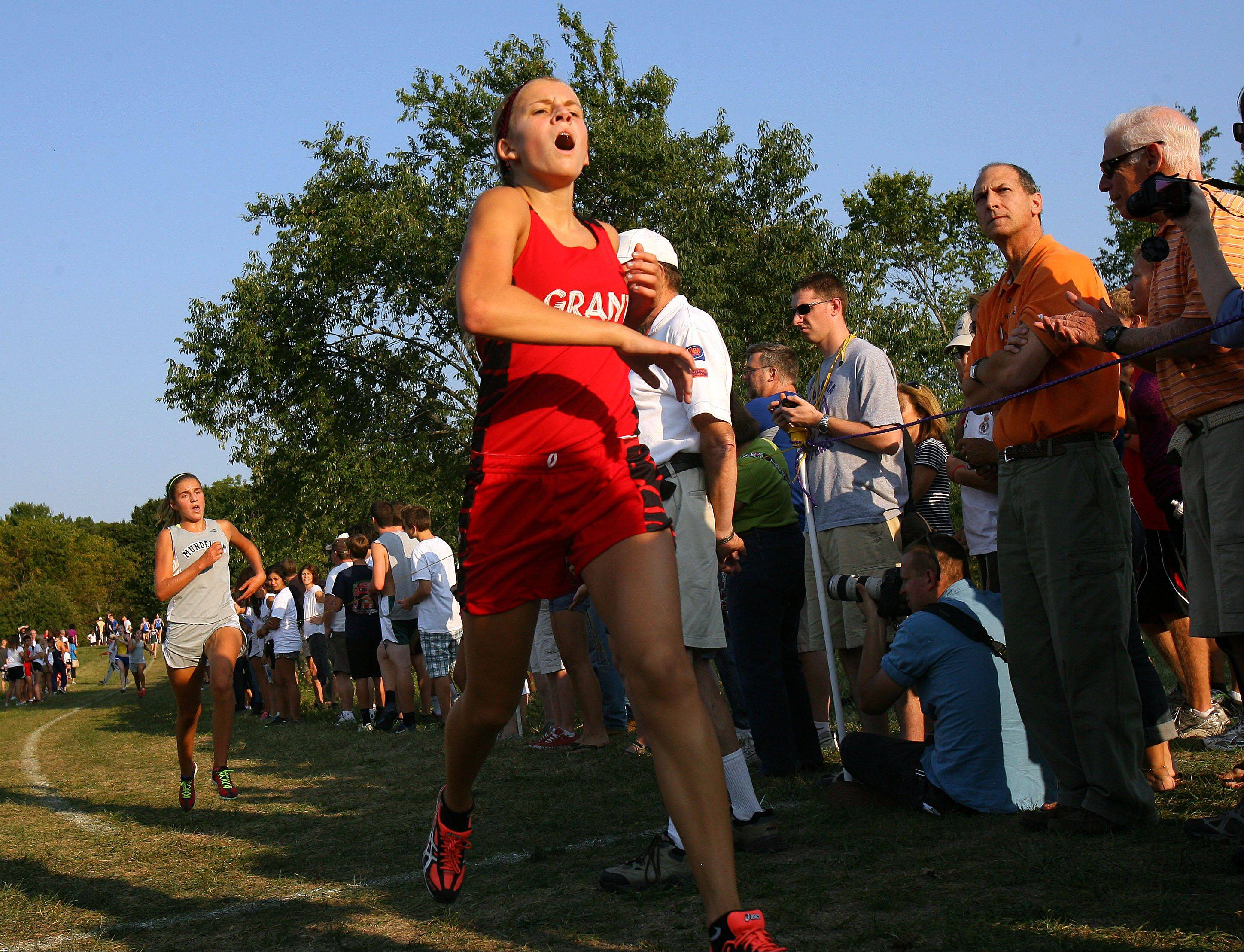Grant's Lindsey Lewis crosses the finish line during the Lake County girls cross country meet Wednesday at Lakewood Forest Preserve near Wauconda.