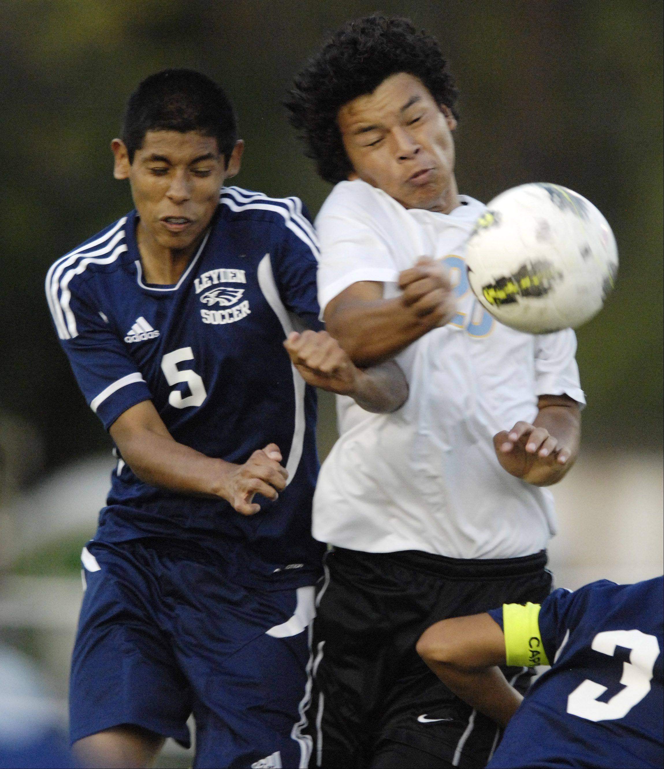 Leyden's Moises Merlos, left, and Maine Wests' Nelson Herrara leap in an effort to control the ball during Wednesday's soccer game.
