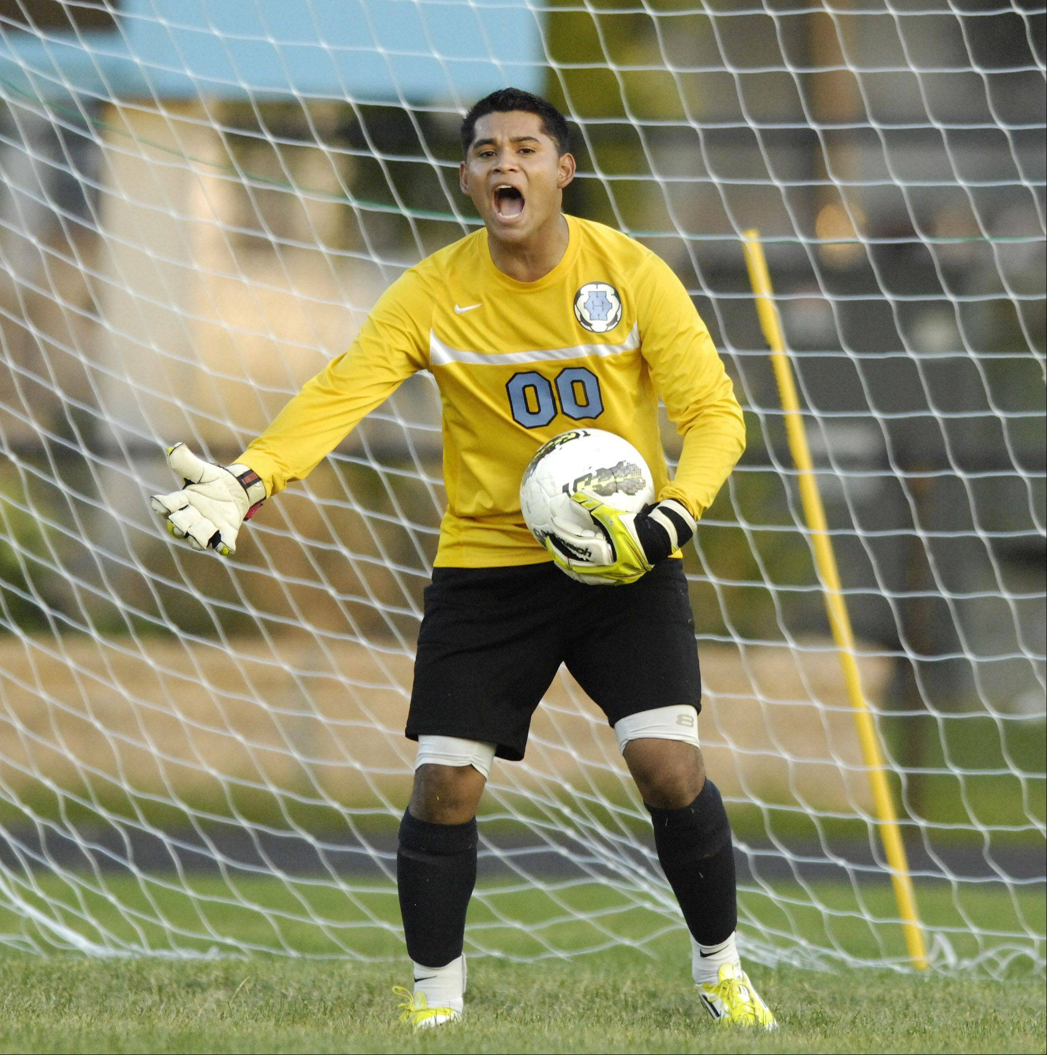 Maine West goal keeper Jecsan Torres takes charge during a game against Leyden.