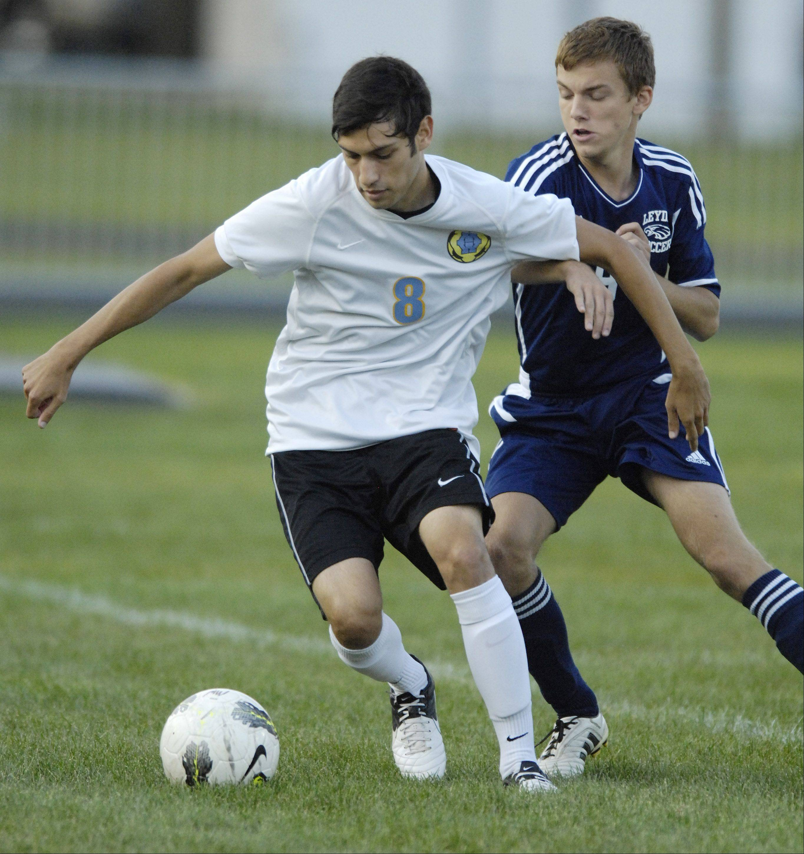 Maine West's Joshua Deleon, left, steps in front of Leyden's Kevin Ziobro to control the ball during Wednesday's game.