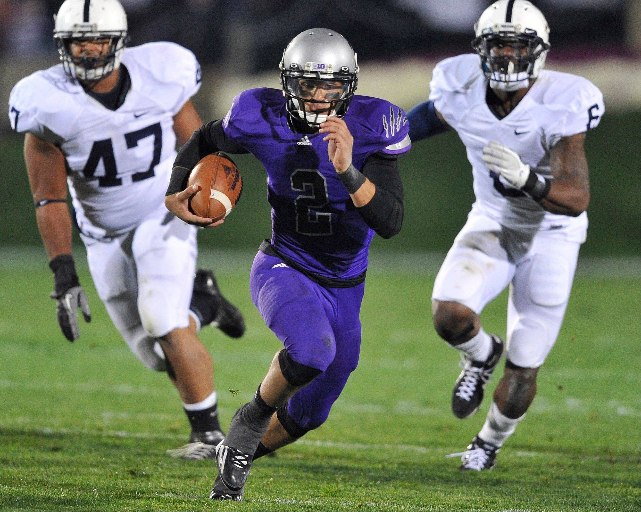In this Oct. 22, 2011 file photo, Northwestern quarterback Kain Colter (2) rushes against Penn State in an NCAA college football game in Evanston, Ill. Colter will be the starter when Northwestern begins its season Sept. 1 against Syracuse.