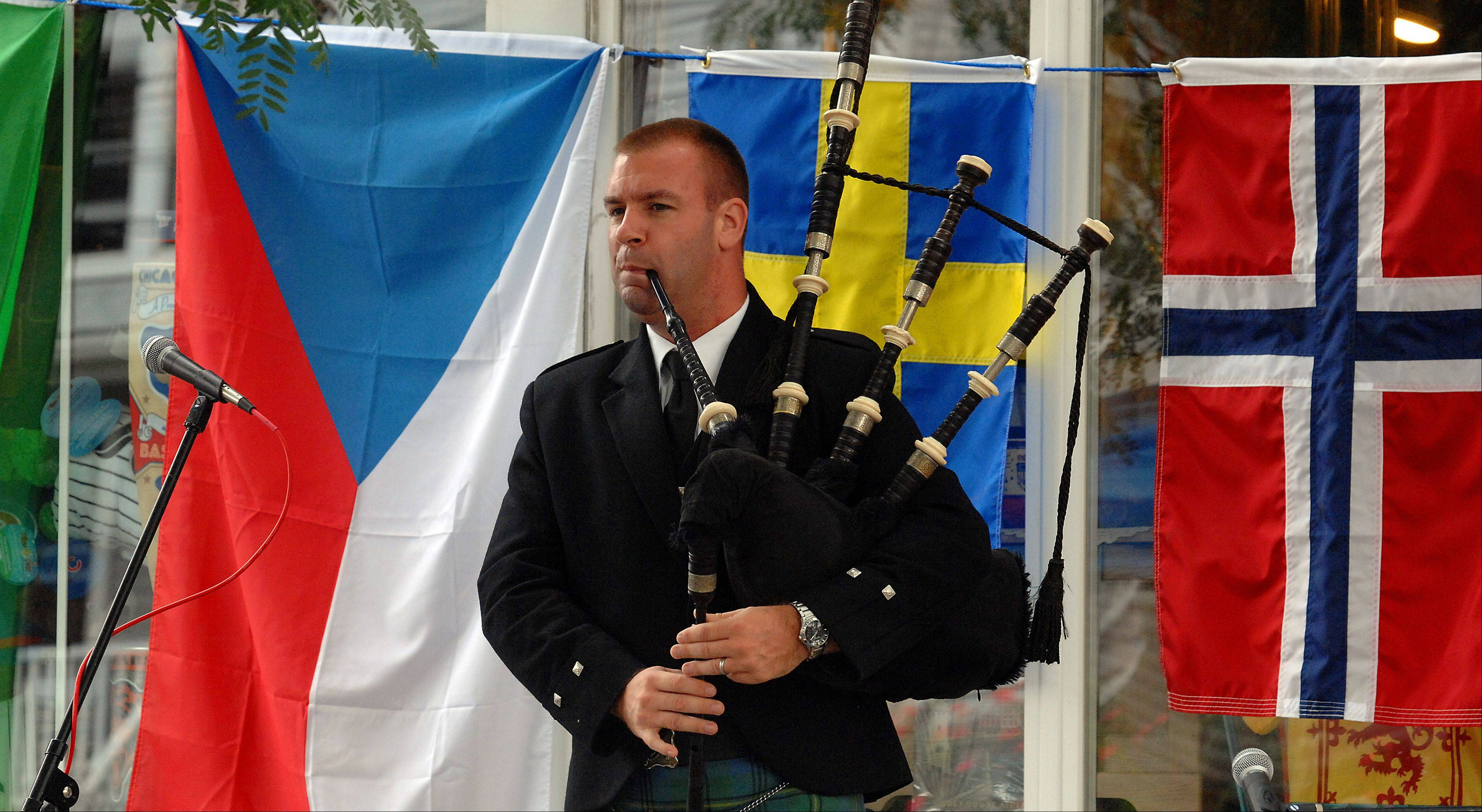 Dave Johnson of Glen Ellyn entertains at the 2011 Long Grove World Tour with his mastery of the bagpipes.