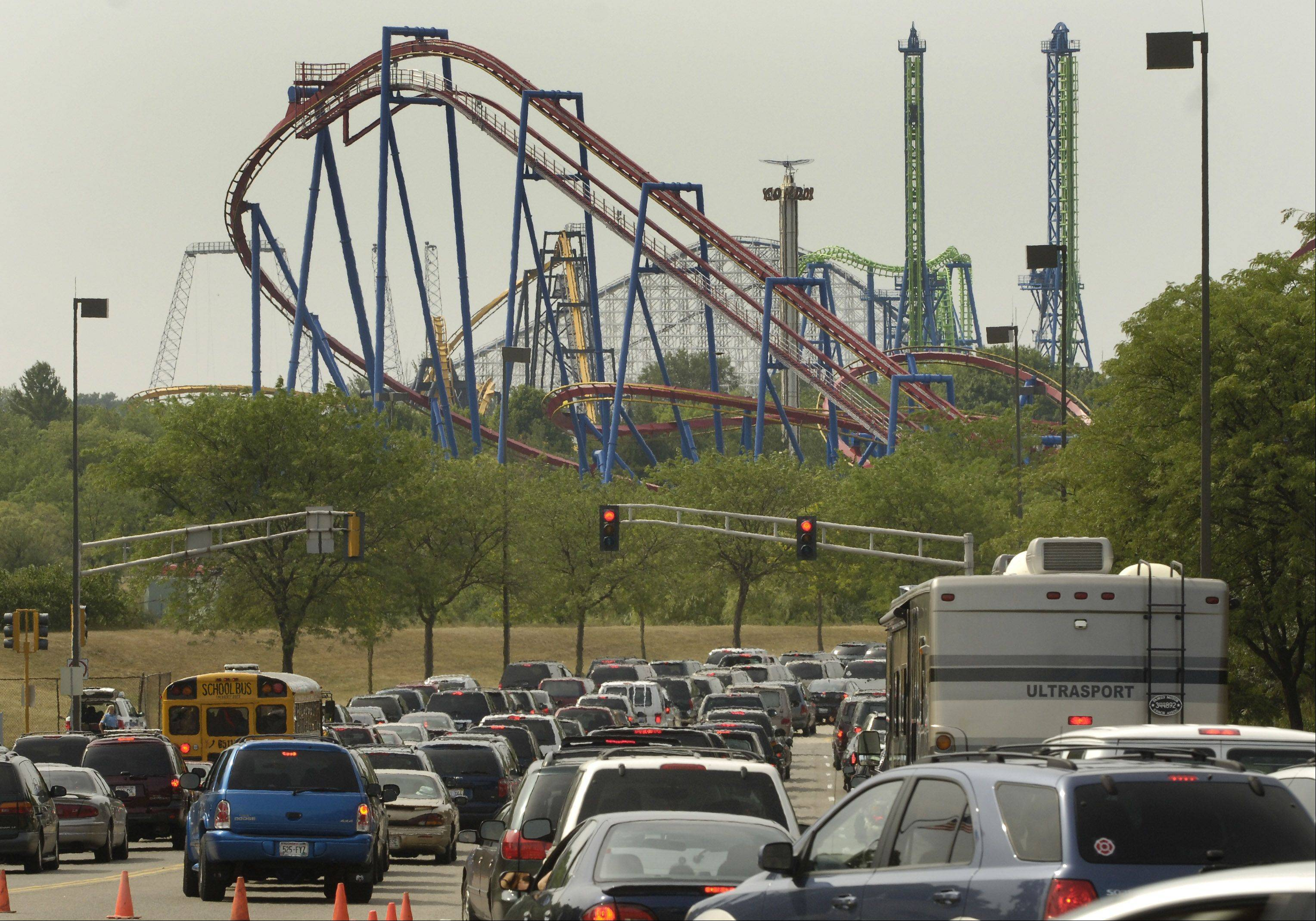 Traffic heading into Gurnee's Six Flags Great America. It's New Jersey sister is working at becoming the world's largest theme park.