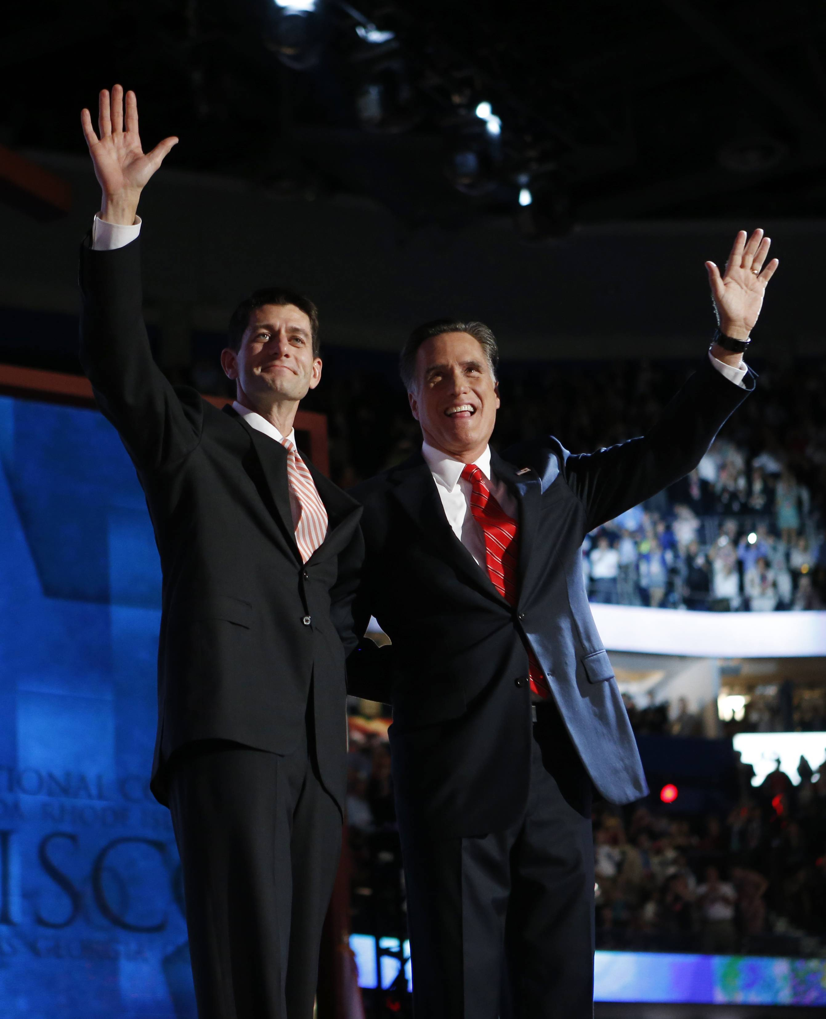 Republican presidential nominee Mitt Romney, right, joined by Republican vice presidential nominee, Rep. Paul Ryan, waves to delegates Thursday after speaking at the Republican National Convention in Tampa, Fla.