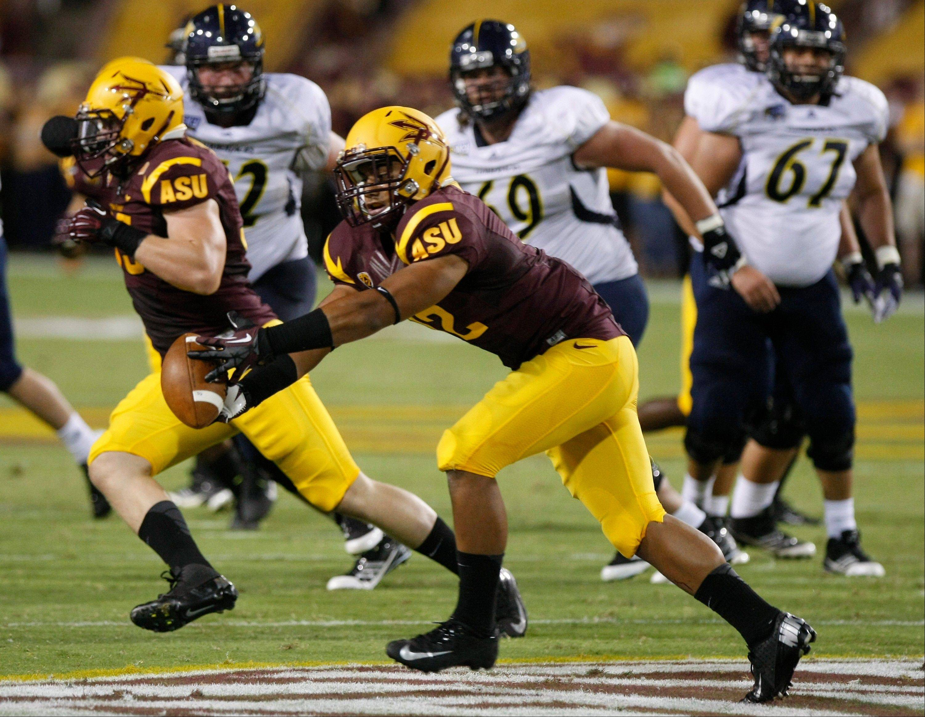 Arizona State safety Viliami Moeakiola intercepts a pass against the Northern Arizona during the first half Thursday in Tempe, Ariz.