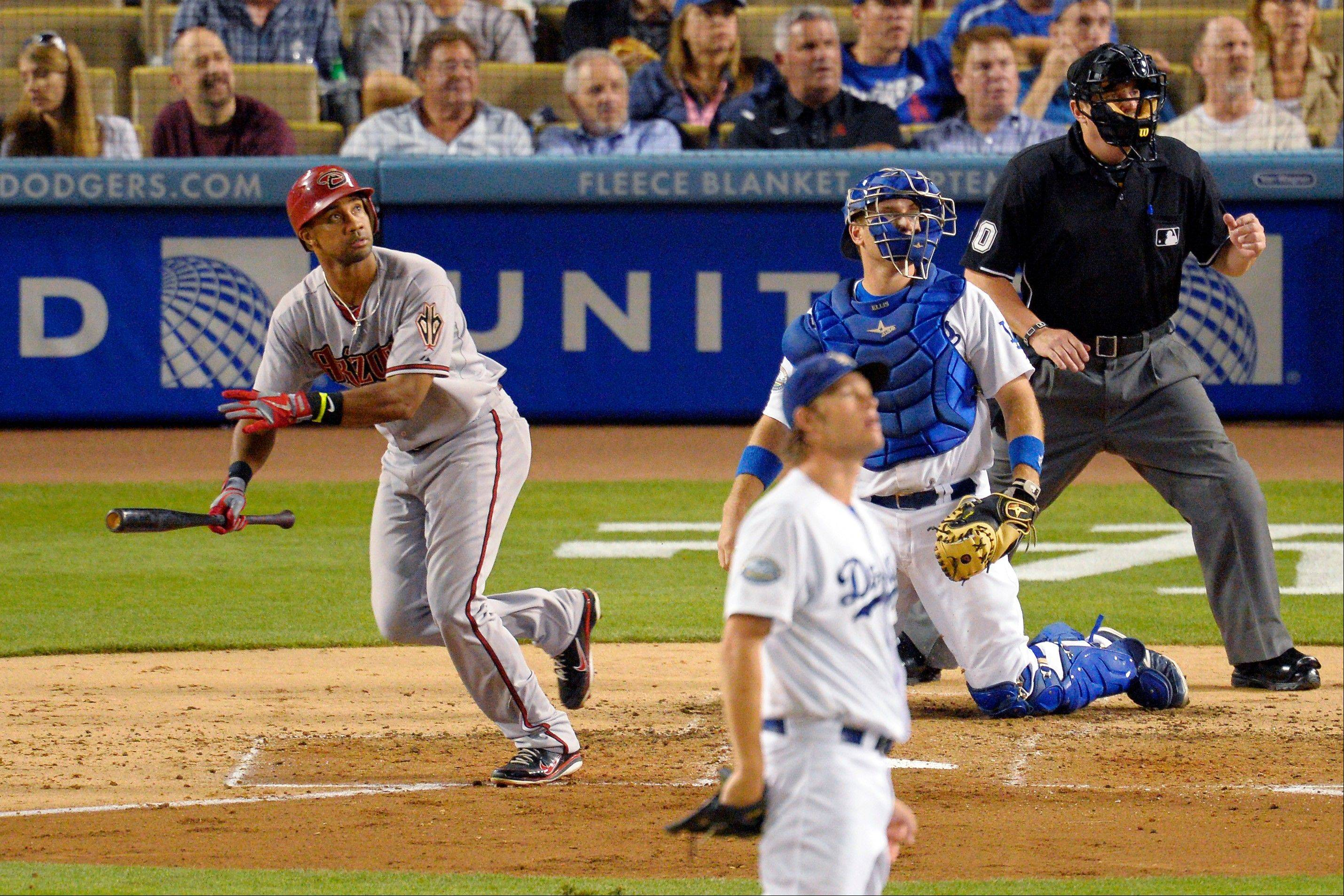 Arizona�s Chris Young, left, follows his two-run home run as Los Angeles Dodgers starting pitcher Clayton Kershaw and catcher A.J. Ellis watch during the fourth inning Thursday in Los Angeles.