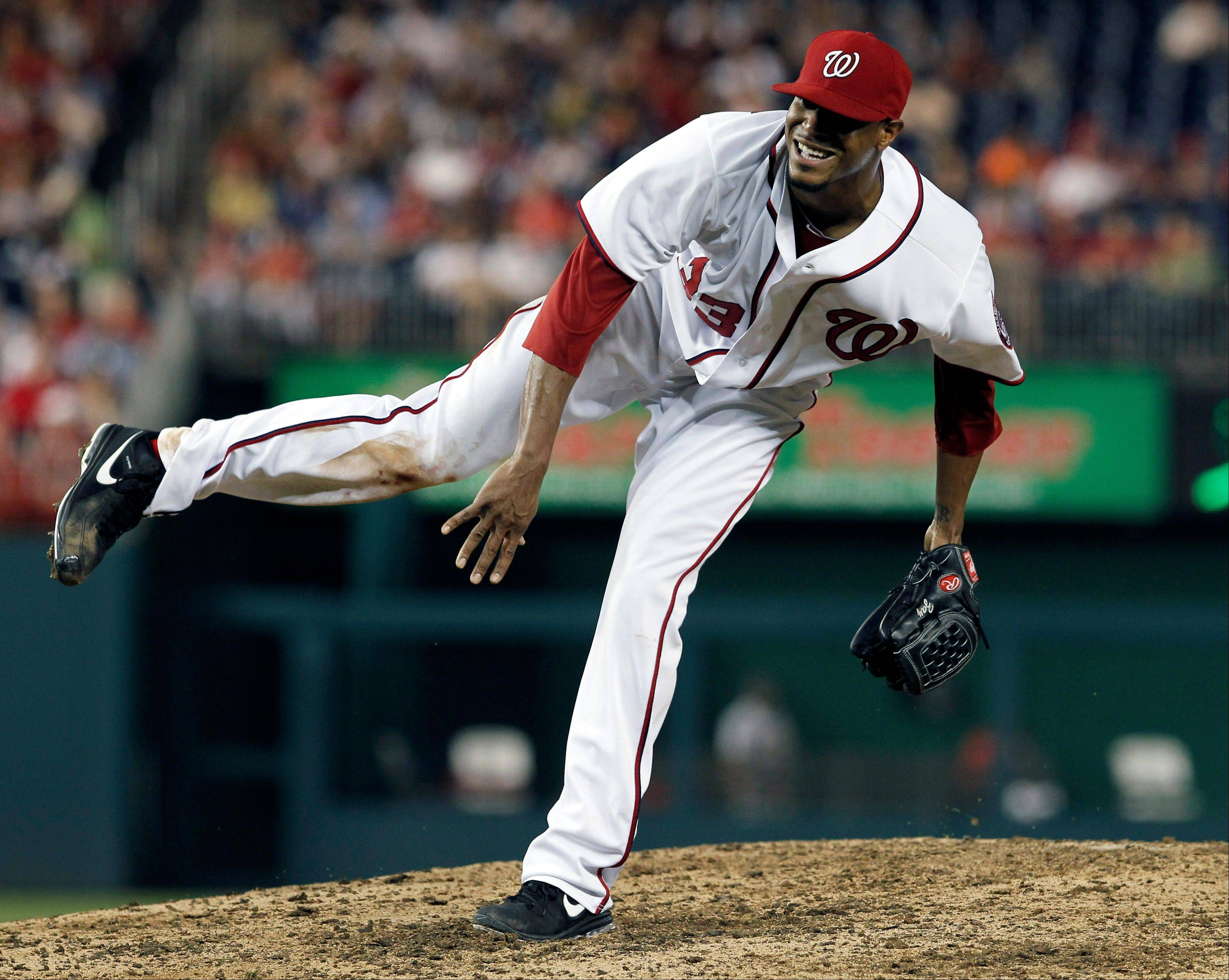 Washington Nationals starting pitcher Edwin Jackson follows through on a pitch during the eighth inning Thursday at home against St. Louis.