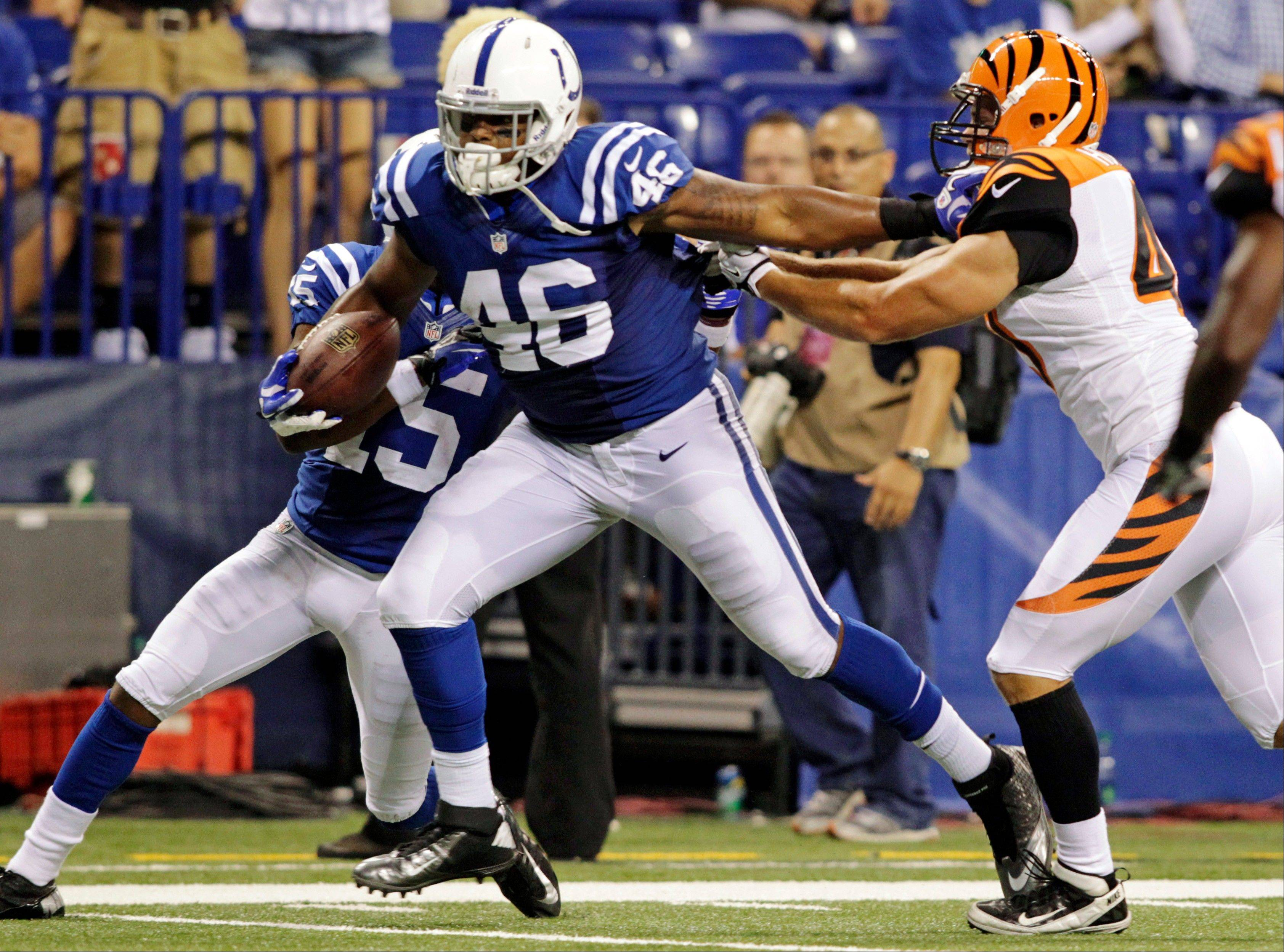 Colts tight end Dominique Jones (46) breaks away from Cincinnati Bengals defensive back T.J. Heath on his way to a touchdown in the second half of a preseason game Thursday in Indianapolis.