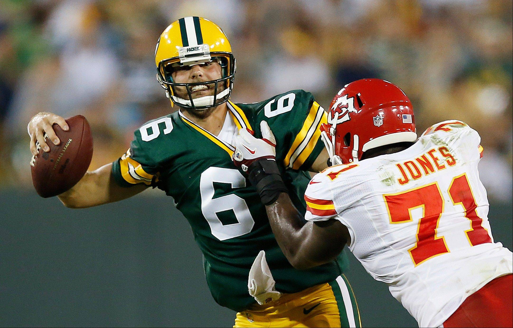 Kansas City�s Jeff Allen pressures Green Bay Packers quarterback Graham Harrell during the second half of a preseason game Thursday in Green Bay, Wis.