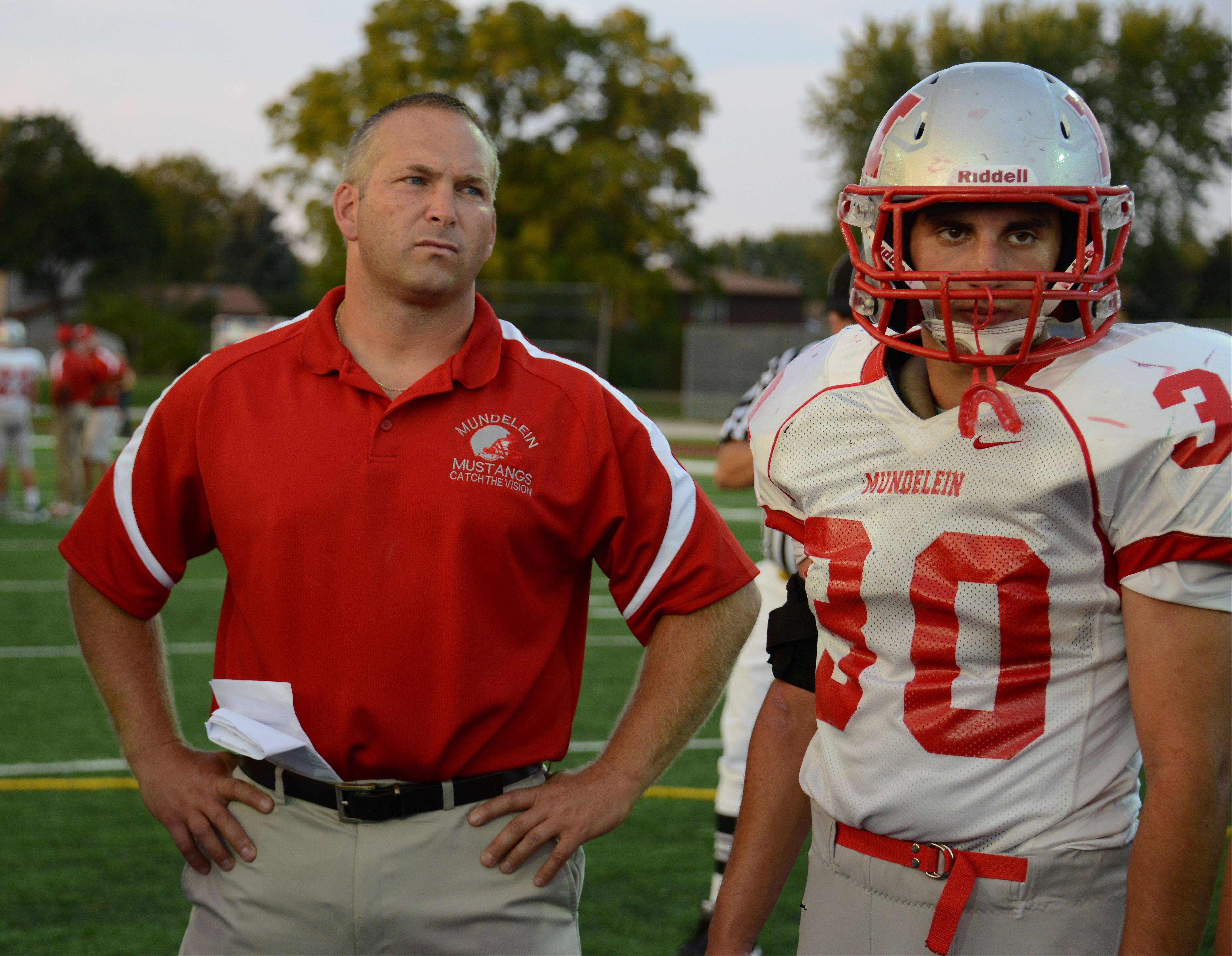 Mundelein football coach George Kaider and senior defensive end Mike Miranda, right, know bullying is a big problem in high school.