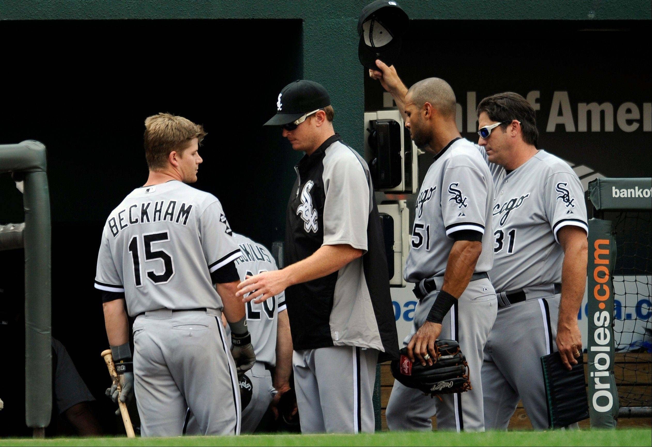The White Sox�s Gordon Beckham (15), Alex Rios (51), batting coach Jeff Manto (31) and others leave the dugout Thursday after losing to the Baltimore Orioles 5-3 in Baltimore.