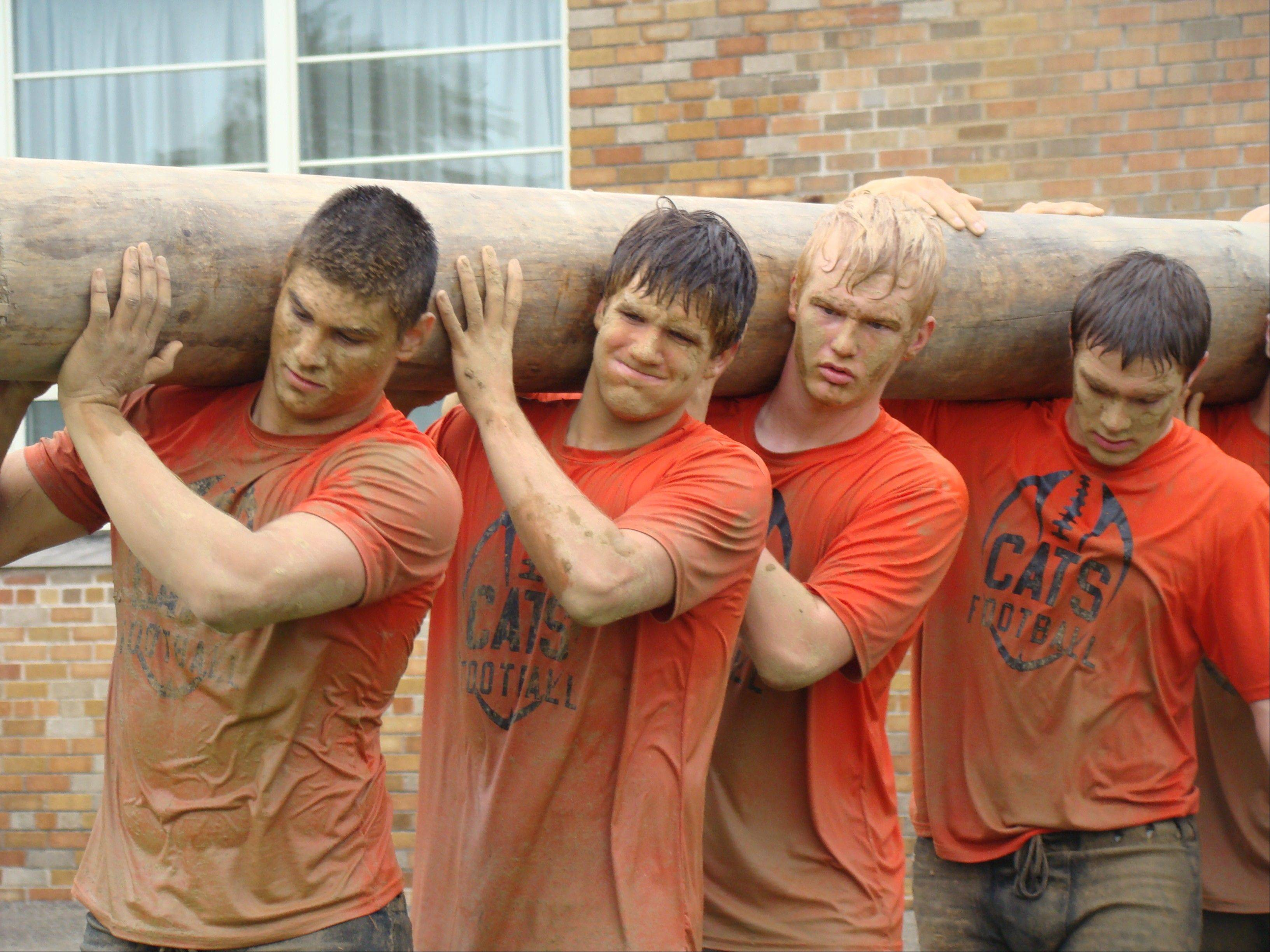From left, Libertyville's Matsen Dziedzic, Jack Deichl, Justin Jost, Joey Nield log some serious work as part of their Navy SEALs training program.