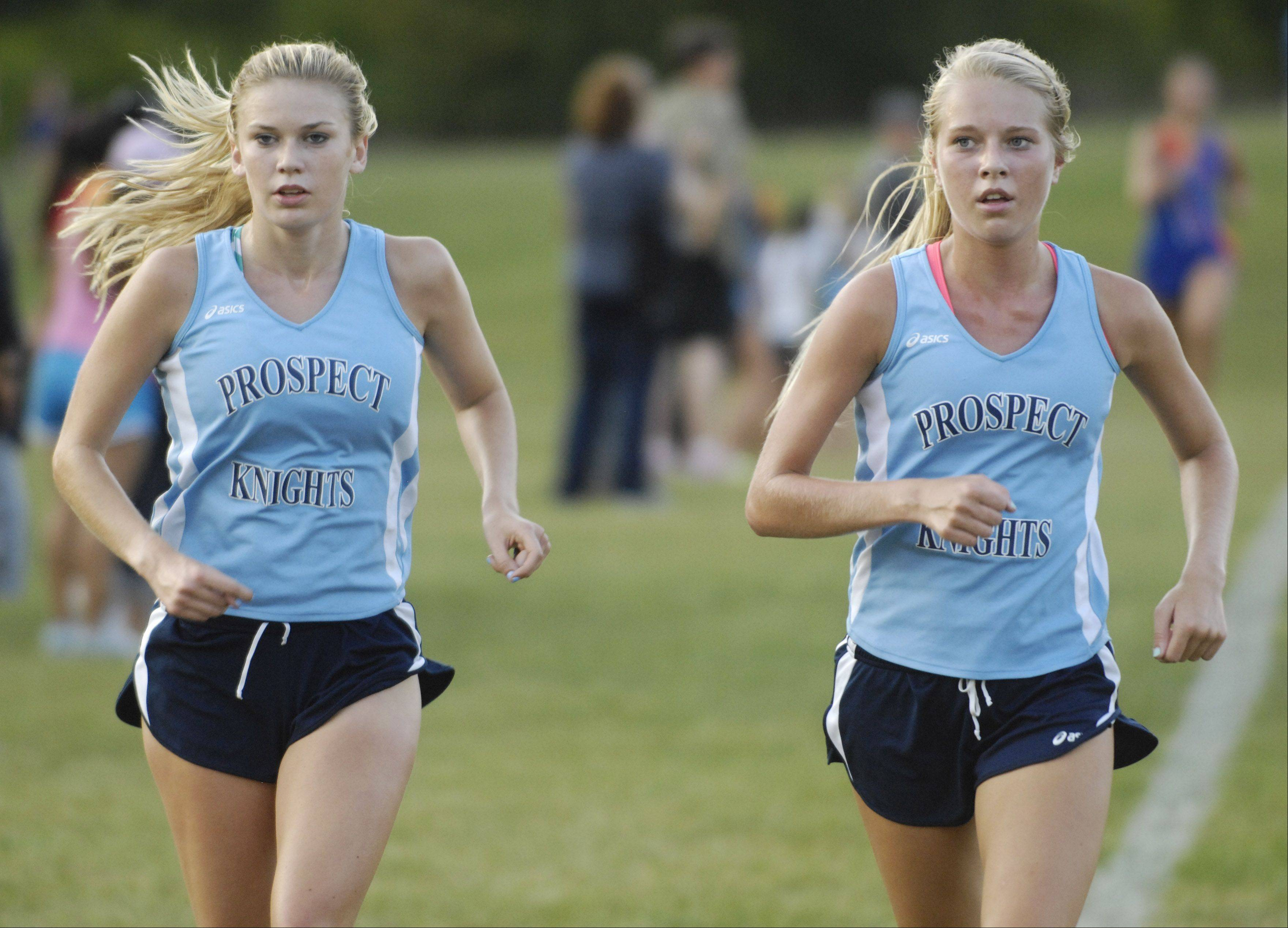 Prospect cross country runners Brooke Wolfe, left, and Lauren Poplowski are aiming for conclude their standout careers with a state trophy.