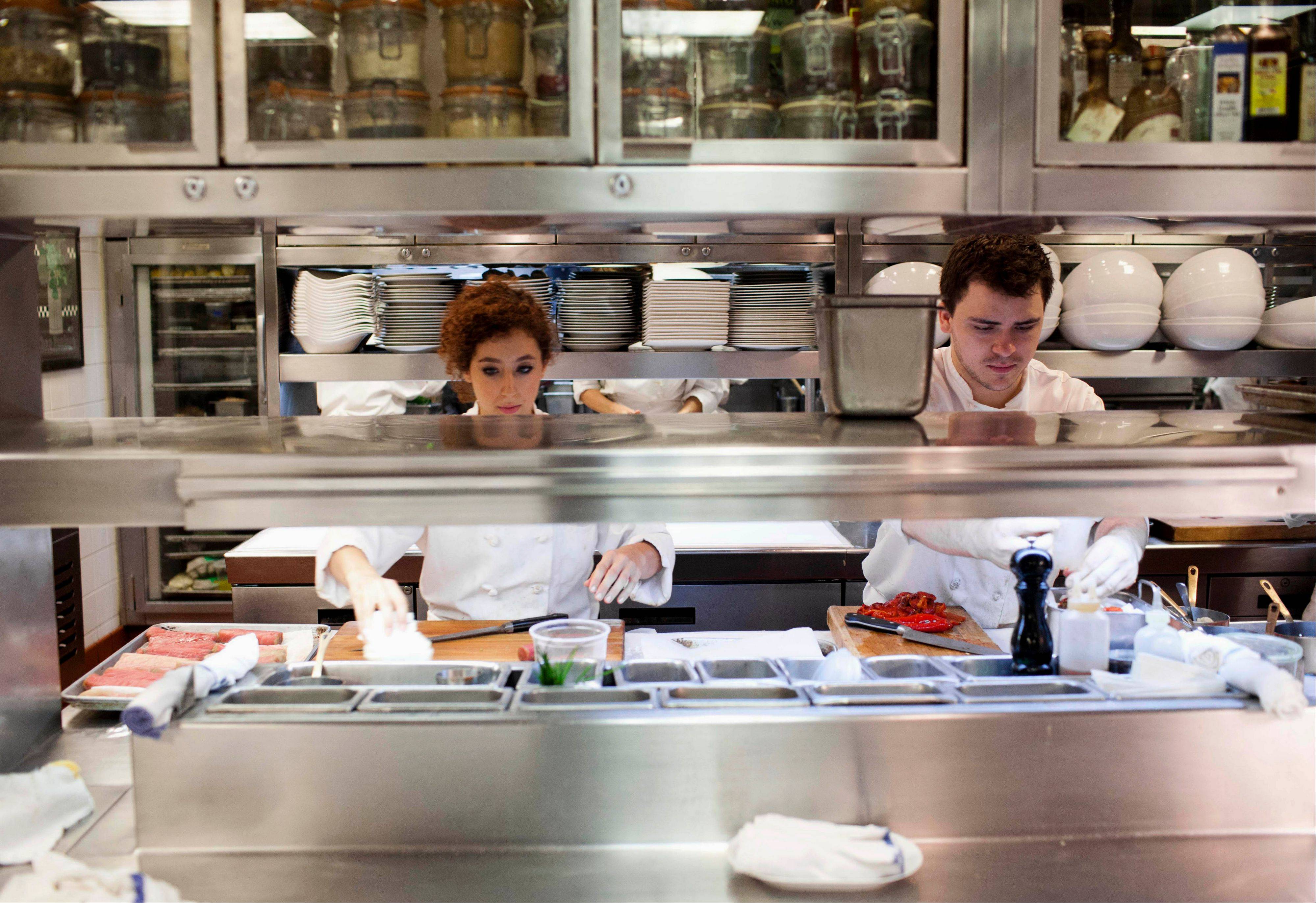 Employees at Charlie Trotter's restaurant in Chicago prepare for dinner on Tuesday.