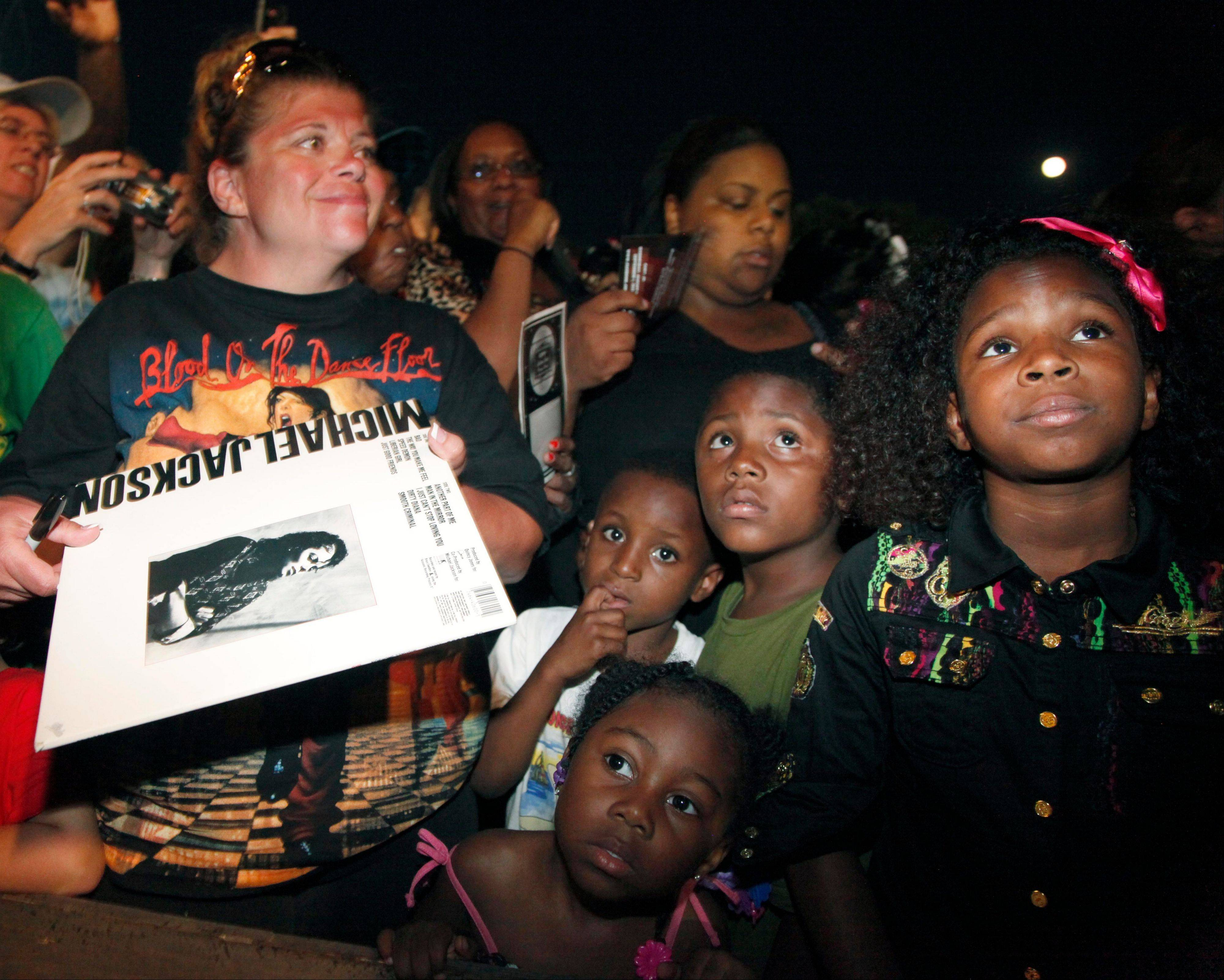 Michael Jackson fans wait to get autographs from his three children -- Prince, Paris, and Blanket -- outside Jackson's boyhood home in Gary, Ind., during a celebration on what would have been Jackson's 54th birthday Wednesday.