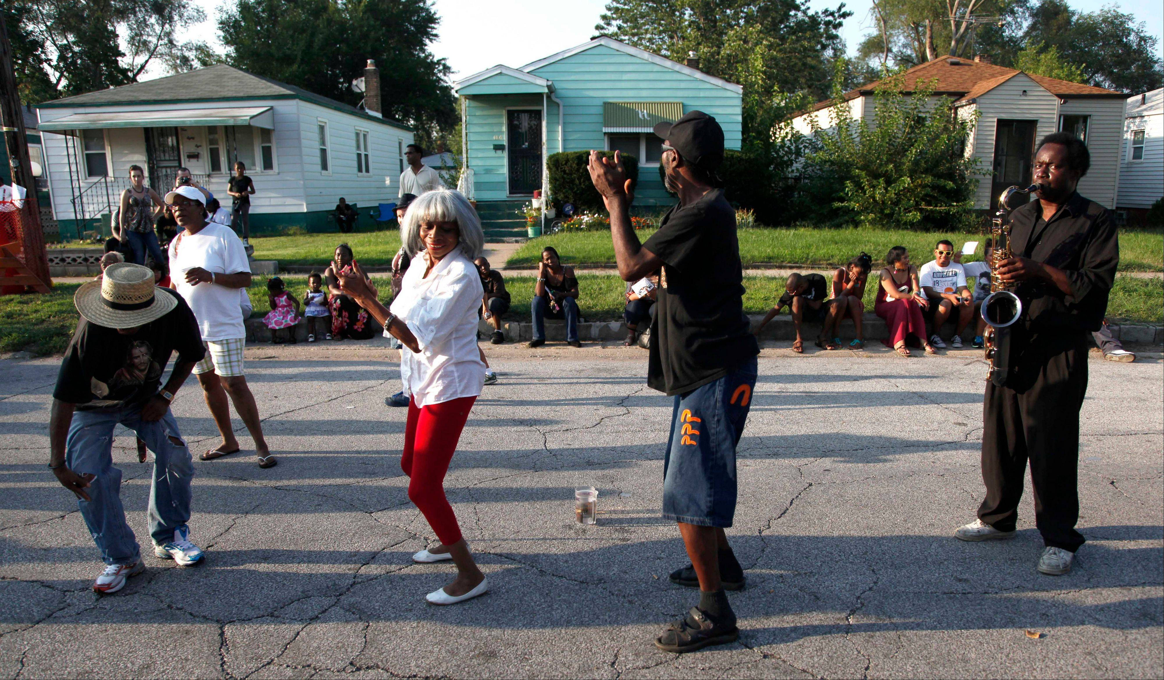 Gary Ind., residents dance to recorded music outside Jackson's boyhood home during celebrations marking what would have been Jackson's 54th birthday Wednesday.