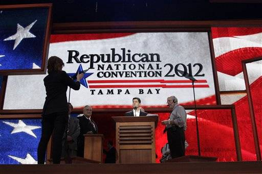 A stage hand adjusts the TelePrompTer for Republican vice presidential candidate, Rep. Paul Ryan, R-Wis., during a walk through ahead of his  speech.
