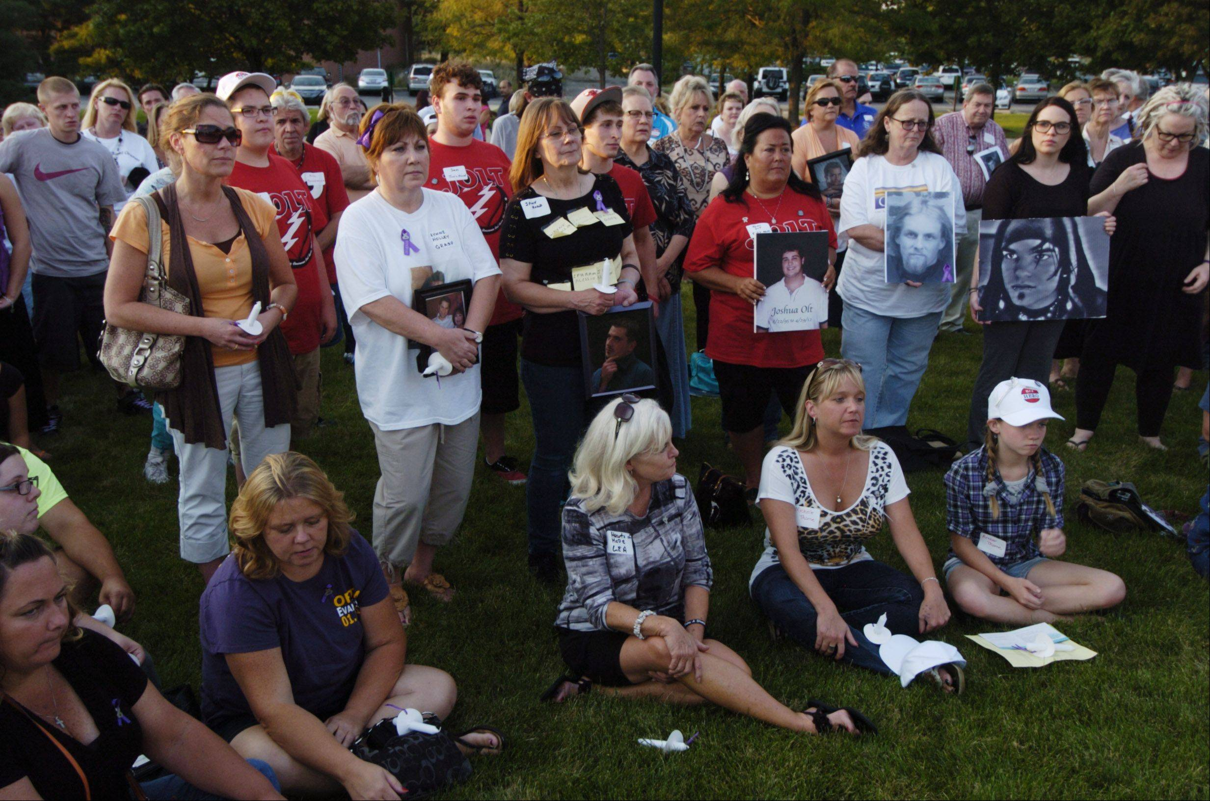 JOE LEWNARD/jlewnard@dailyherald.comFriends and family members of overdose victims gather during a candlelight vigil and remembrance ceremony Thursday at Roosevelt University in Schaumburg.