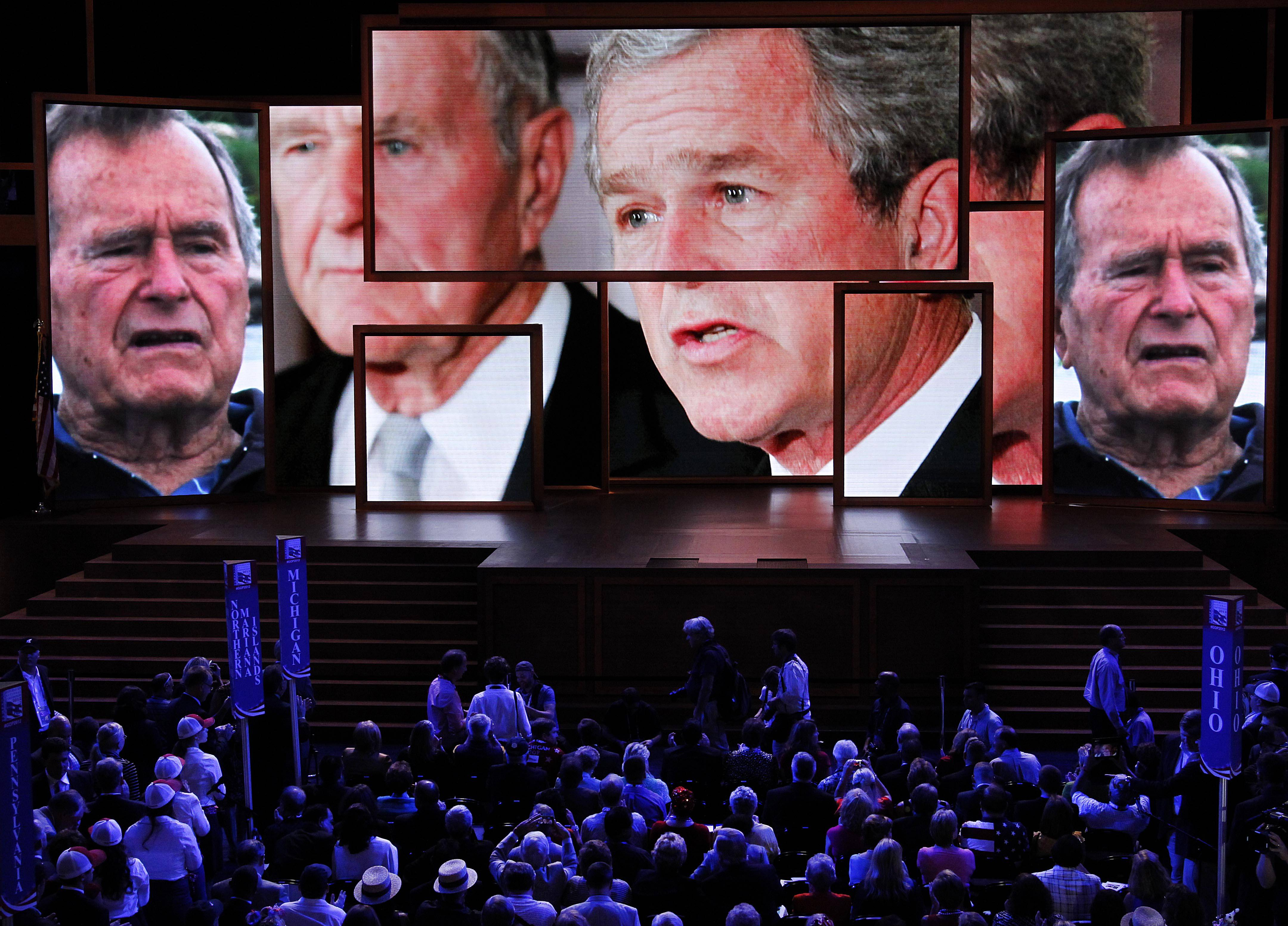 A video tribute to President George H. W. Bush and President George W. Bush is shown Wednesday during the Republican National Convention in Tampa, Fla.