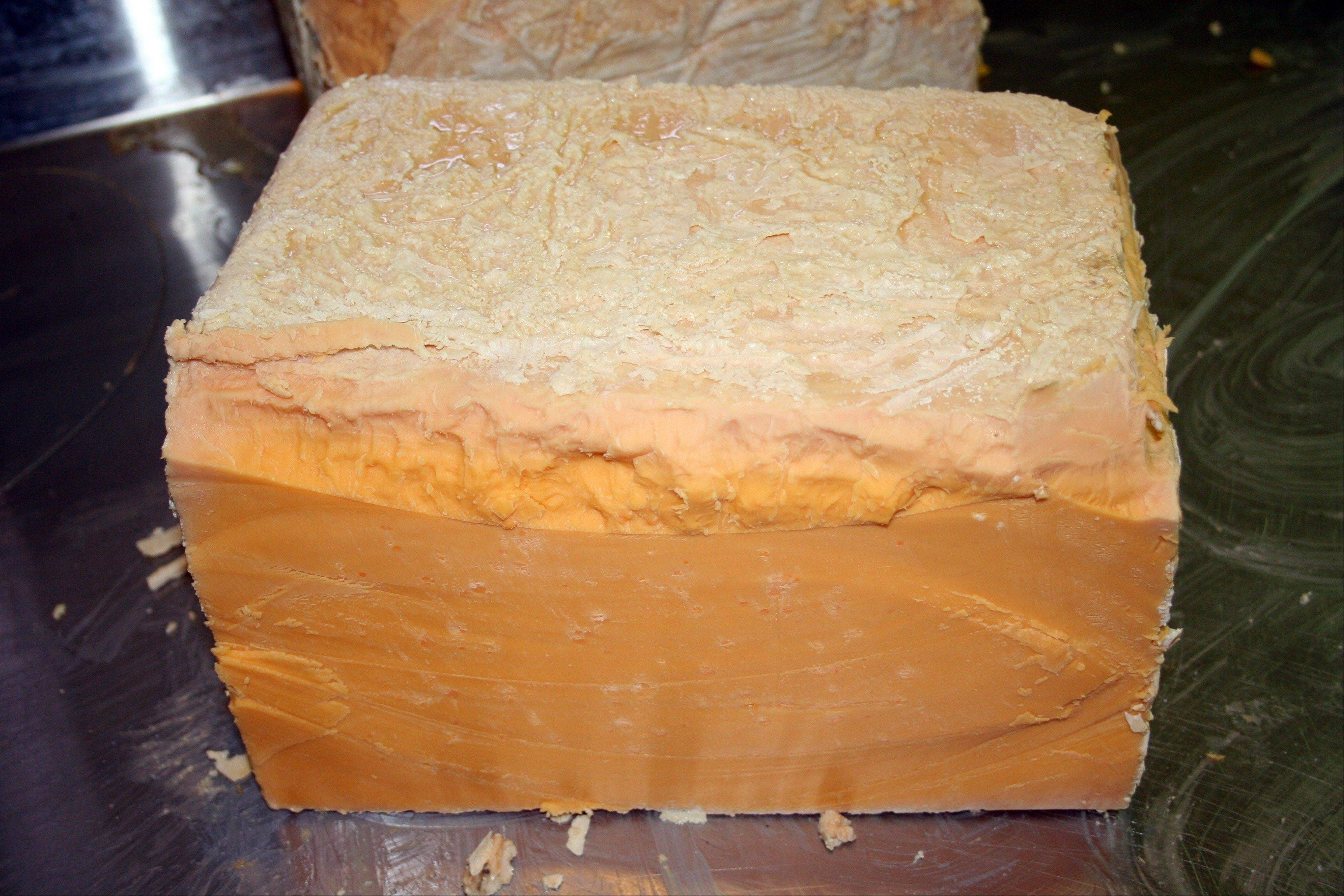This photo provided by Kenneth McNulty shows a 28-year-old block of cheddar, one of three boxes of unintentionally aged cheddar recently discovered in a Milwaukee cheese market. The three boxes -- 28, 34 and 40 years old -- will be auctioned to the public. Some experts say it might be the oldest collection of cheese ever assembled.