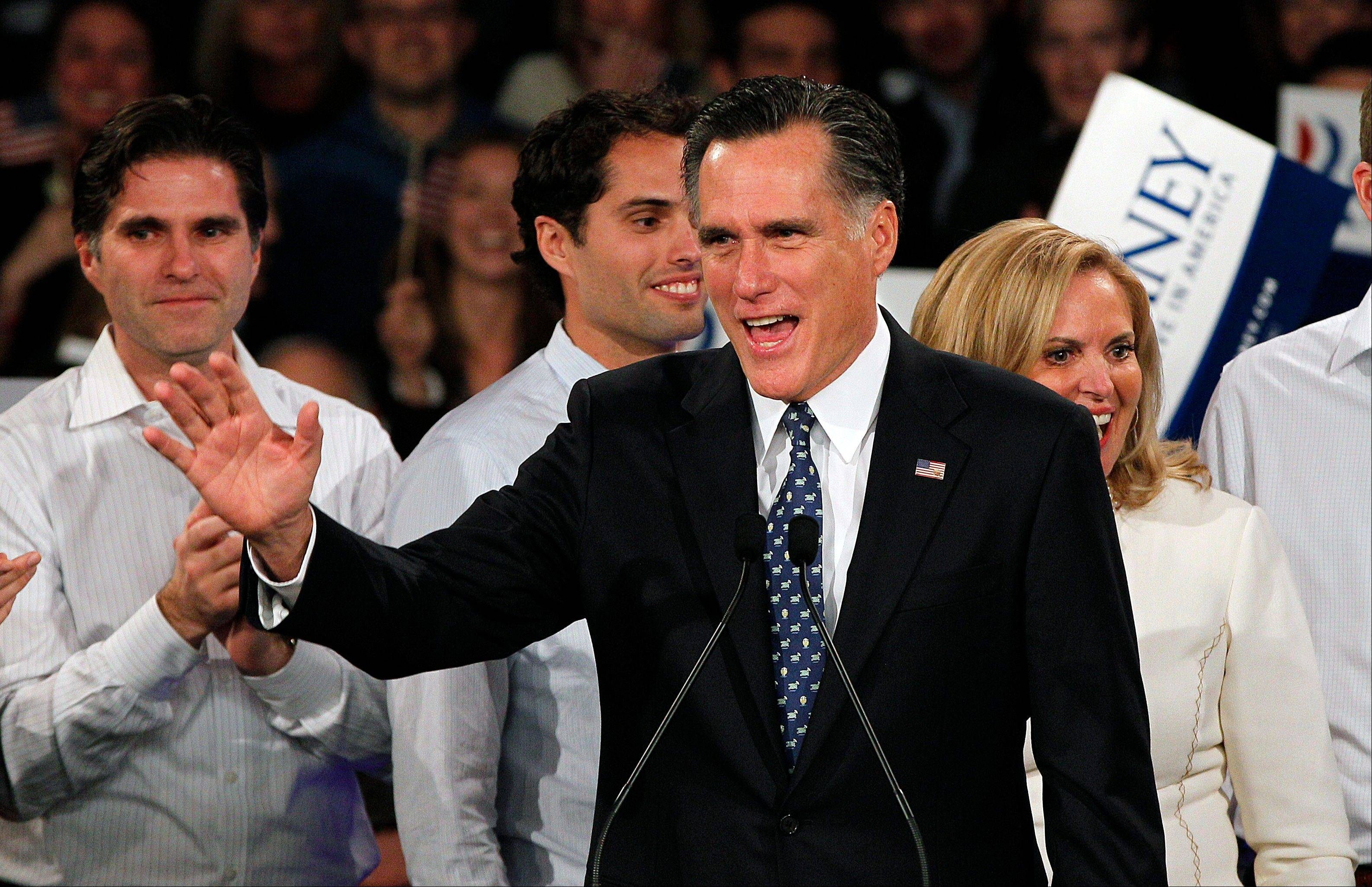 Former Massachusetts Gov. Mitt Romney gets family support at a rally with sons Tagg, from left, and Craig and wife Ann.