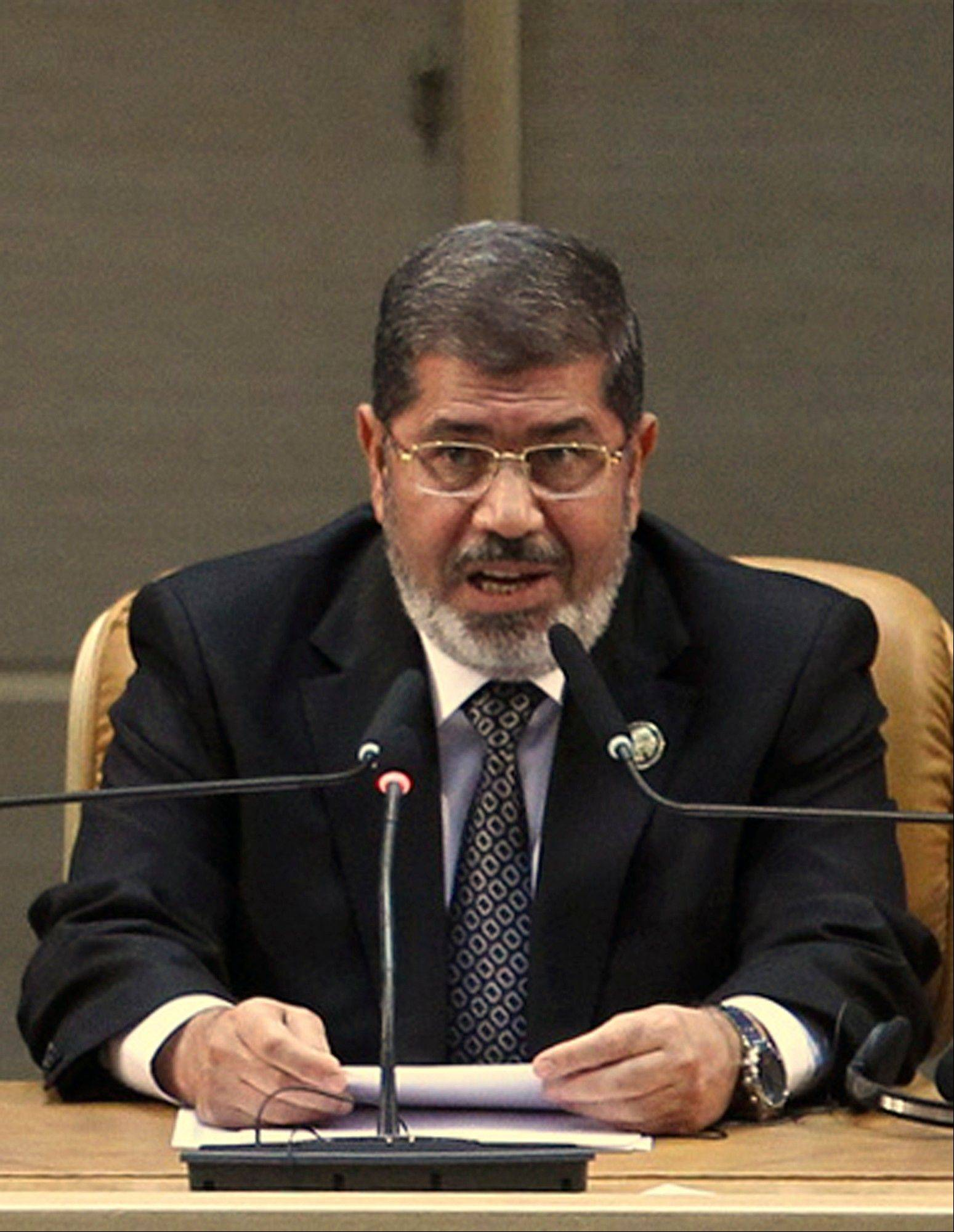Egyptian President Mohammed Morsi addresses a summit of the Nonaligned Movement in Tehran, Iran, Thursday, Aug. 30, 2012. Morsi arrived in Tehran on Thursday in the first visit by an Egyptian leader to Iran after decades of hostility between the two countries.