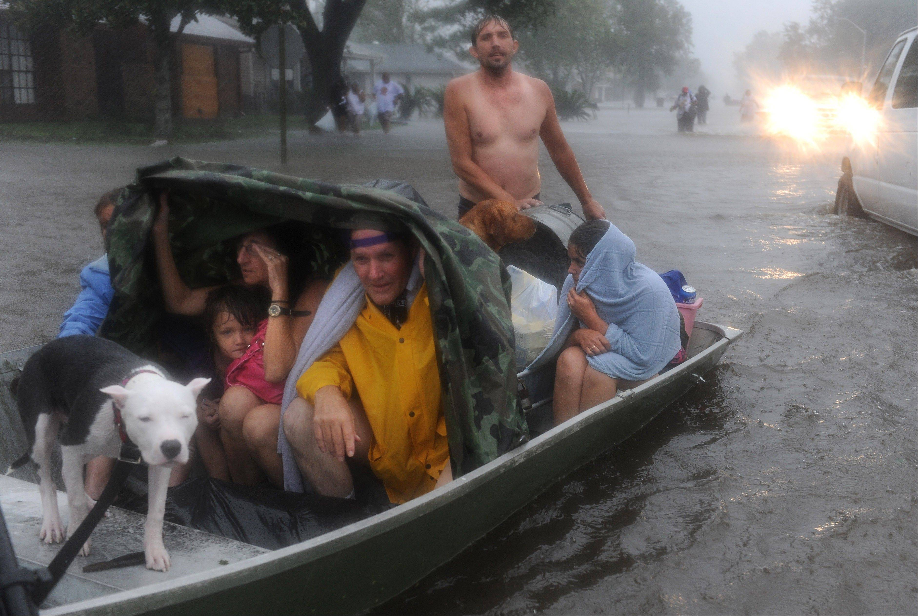 Residents of the Cambridge Neighborhood of LaPlace Louisiana flee rising floodwaters associated with Hurricane Isaac Wednesday.