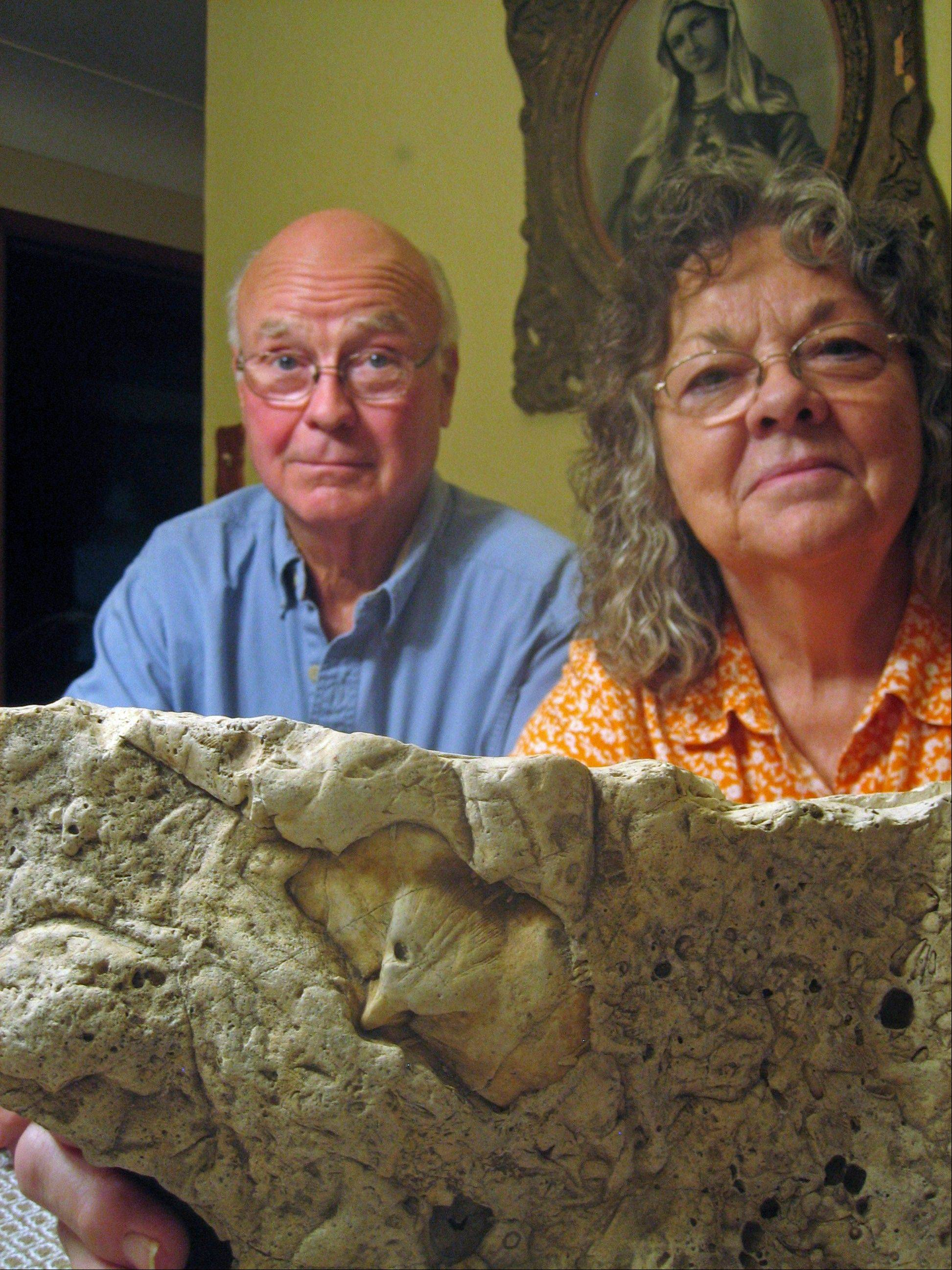 Larry and Barbara Weiss, who live on a country road near Pocahontas, with a 20-pound fossil of a bird.