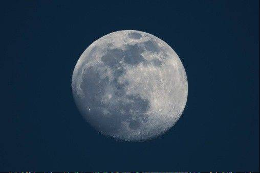 A blue moon occurs when there's a second full moon in one calendar month. The moon actually won't be colored blue.