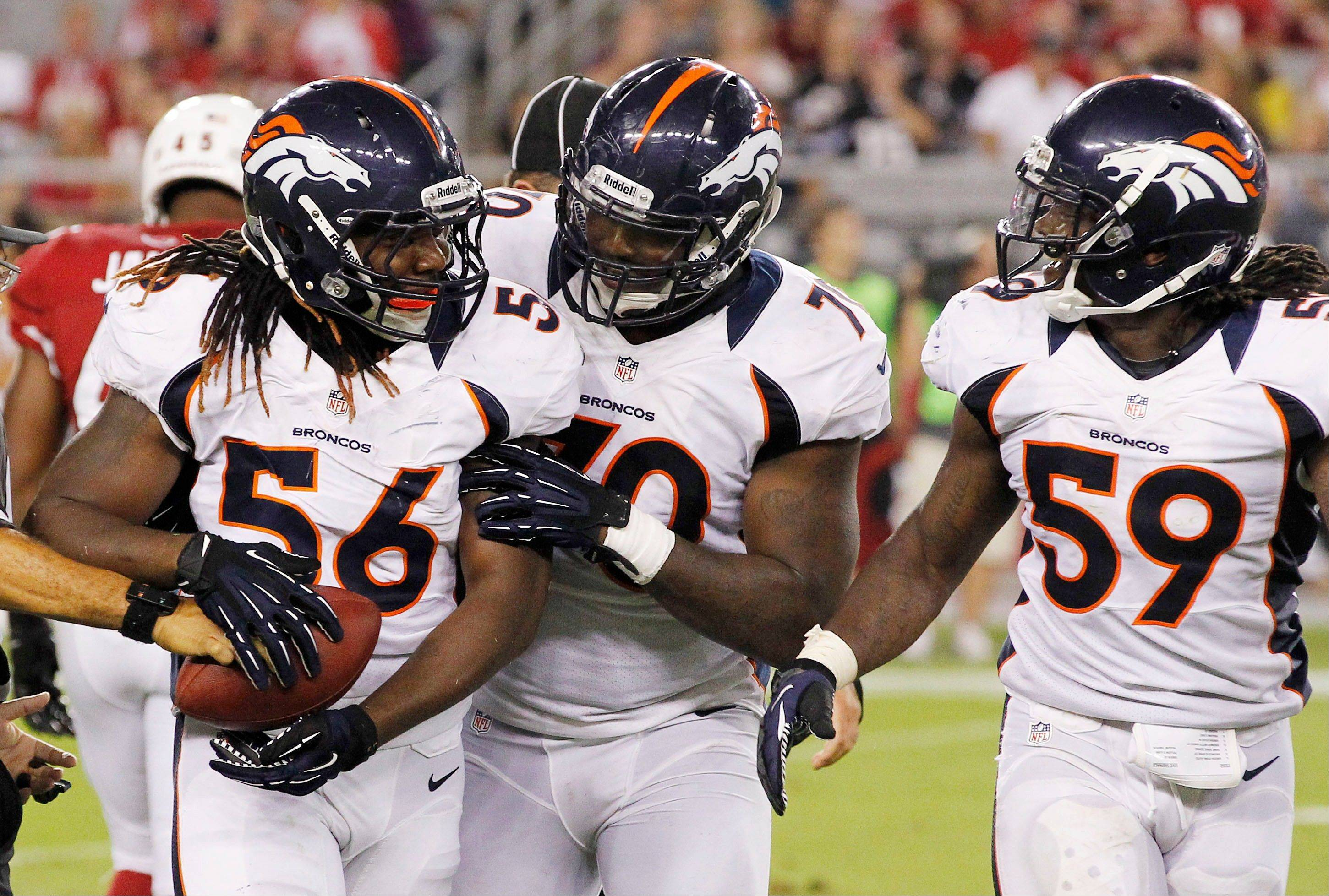 Denver's Nate Irving (56) celebrates his fumble recovery against the Arizona Cardinals with teammates Malik Jackson and Danny Trevathan (59) during the first half of a preseason game Thursday in Glendale, Ariz.