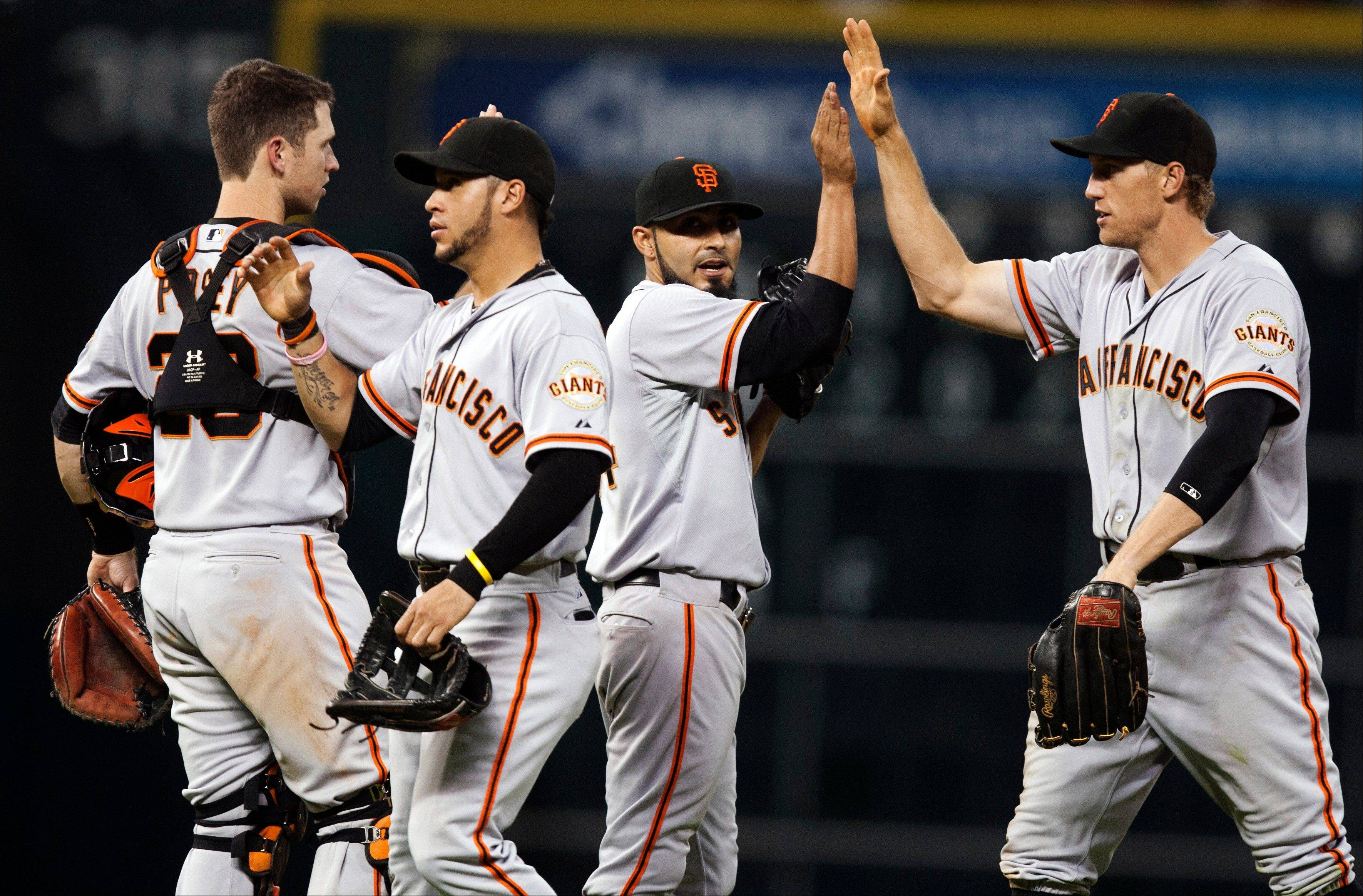 San Francisco Giants relief pitcher Sergio Romo (54) celebrates with teammates after defeating the Houston Astros 8-4 on Thursday in Houston.