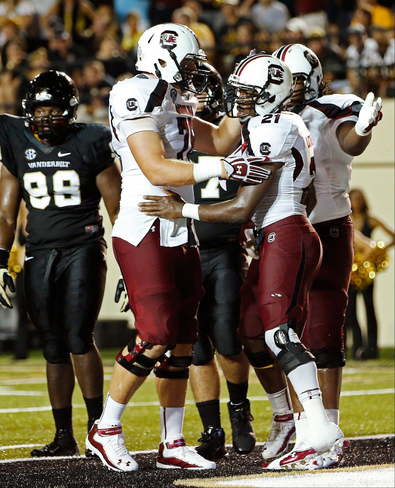 South Carolina's Marcus Lattimore (21) celebrates his game-winning touchdown against Vanderbilt with teammates Thursday in Nashville, Tenn.