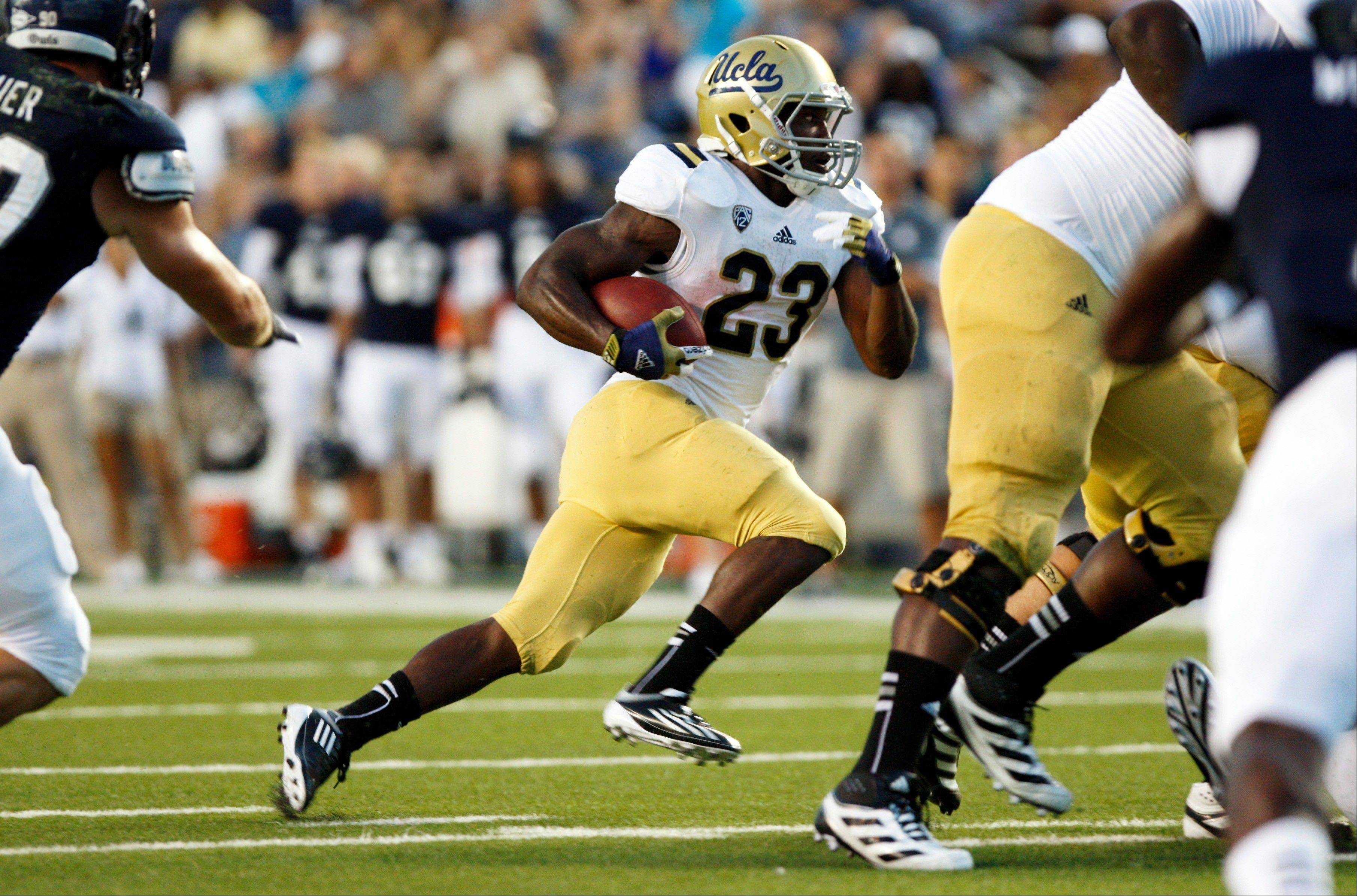 UCLA running back Johnathan Franklin (23) gains yards against Rice during the first half Thursday in Houston.
