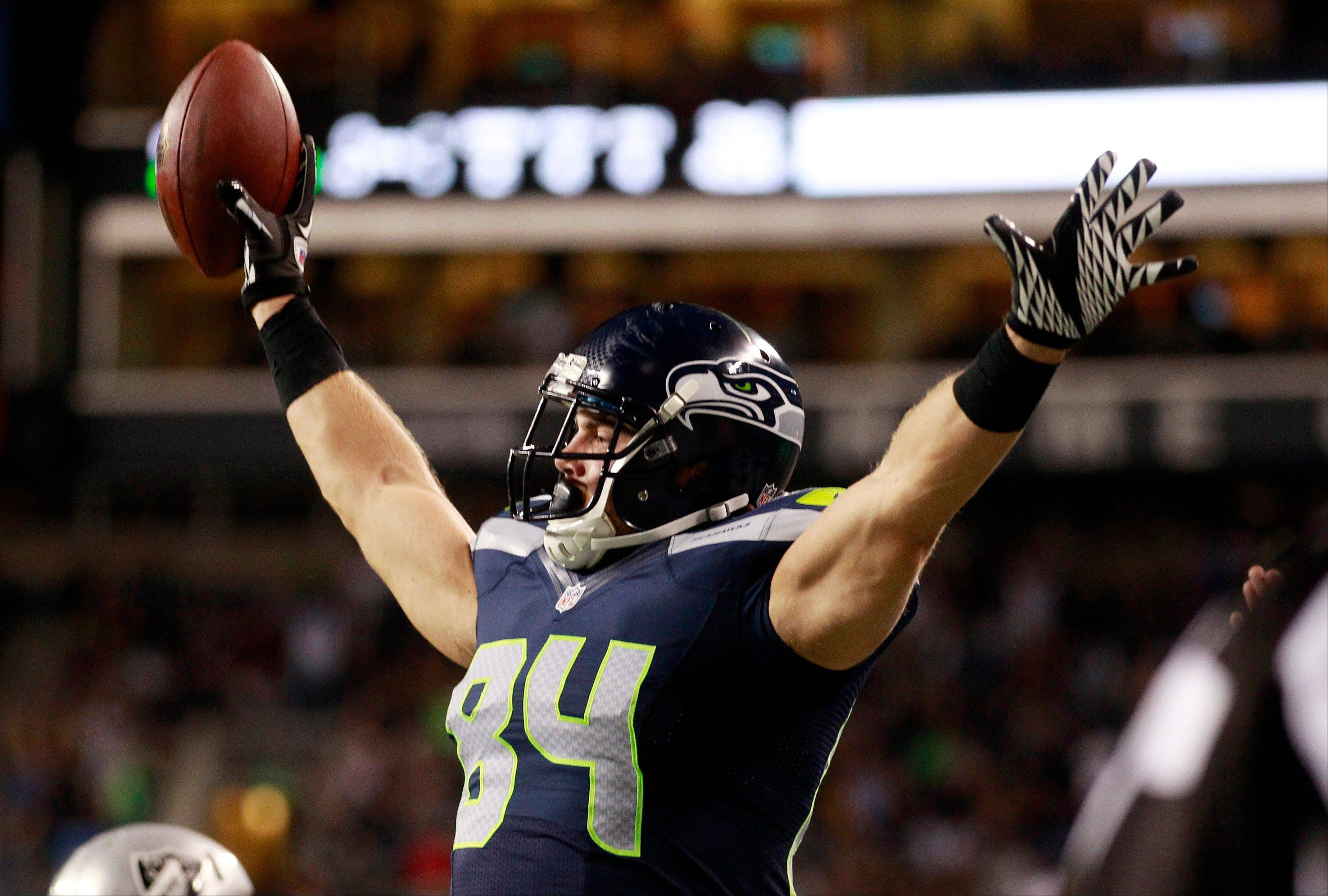 The Seahawks' Cooper Helfet celebrates after scoring a touchdown against the Oakland Raiders in the second half of a preseason game Thursday in Seattle.