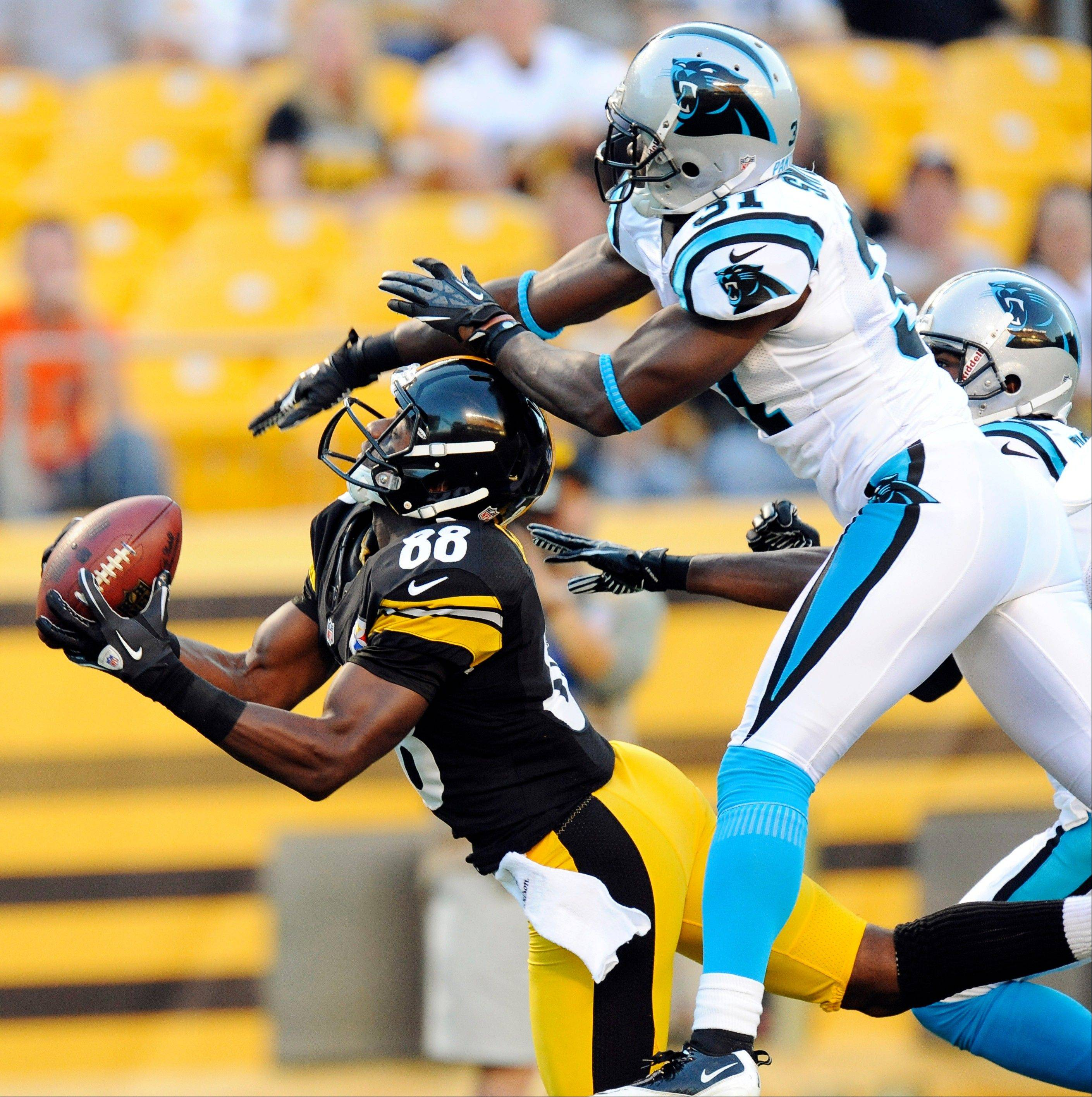 Pittsburgh Steelers wide receiver Emmanuel Sanders catches a throw from Charlie Batch for a touchdown against Carolina in the first quarter of their preseason game Thursday in Pittsburgh.