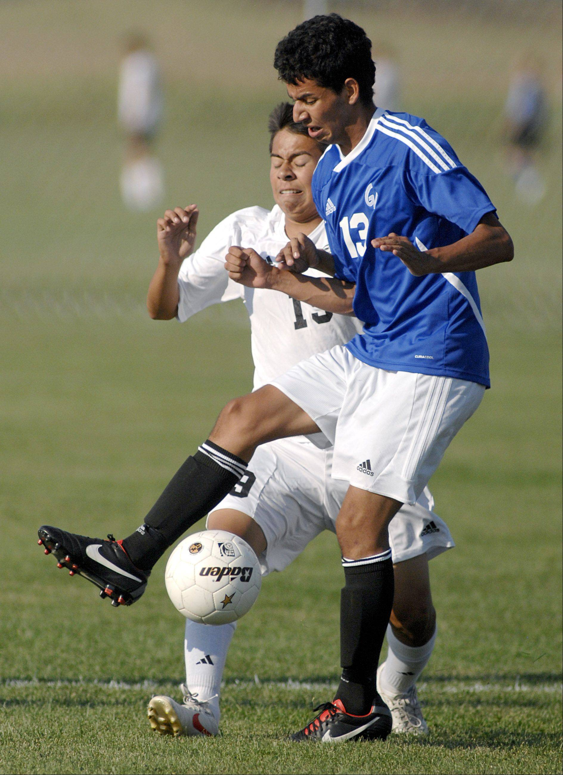 Kaneland's Ivan Bohorquez, left, and Geneva's Valentin Gonzalez fight for the ball in the first half on Thursday, August 30.