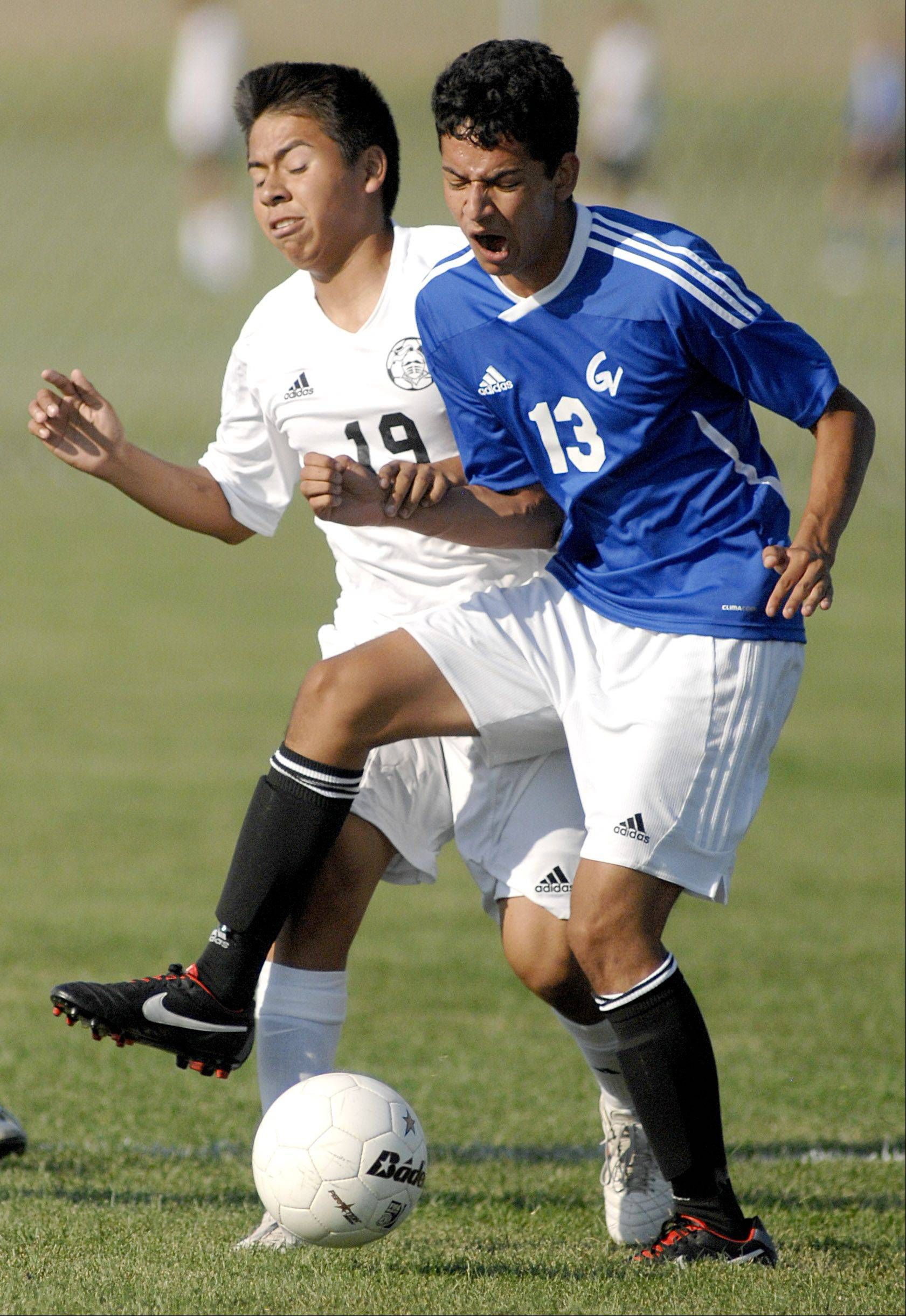 Kaneland's Ivan Bohorquez, left, and Geneva's Valentin Gonzalez battle for the ball in the first half on Thursday, August 30.