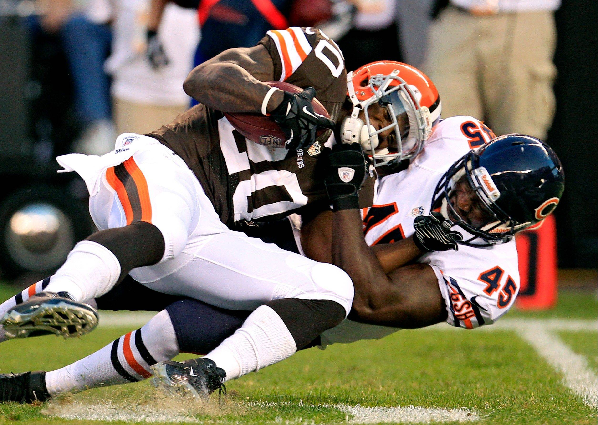 Chicago Bears linebacker Xavier Adibi tackles Cleveland Browns running back Montario Hardesty in the first quarter of a preseason NFL football game Thursday, Aug. 30, 2012, in Cleveland.