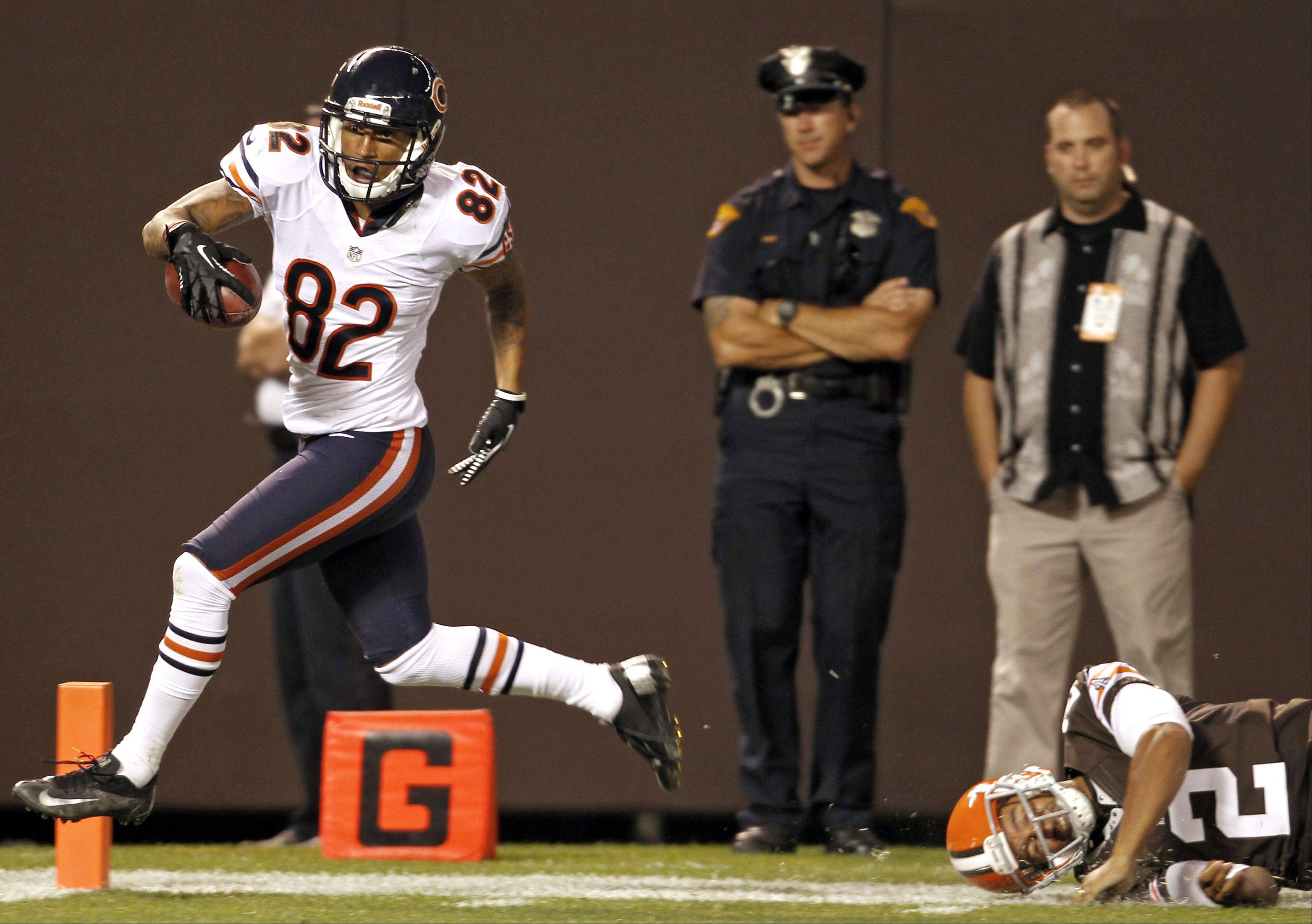 Chicago Bears wide receiver Brittan Golden scores a touchdown on a 15-yard return of a blocked punt on Cleveland Browns' Reggie Hodges in the third quarter of a preseason NFL football game, Thursday, Aug. 30, 2012, in Cleveland. The Bears won 28-20.