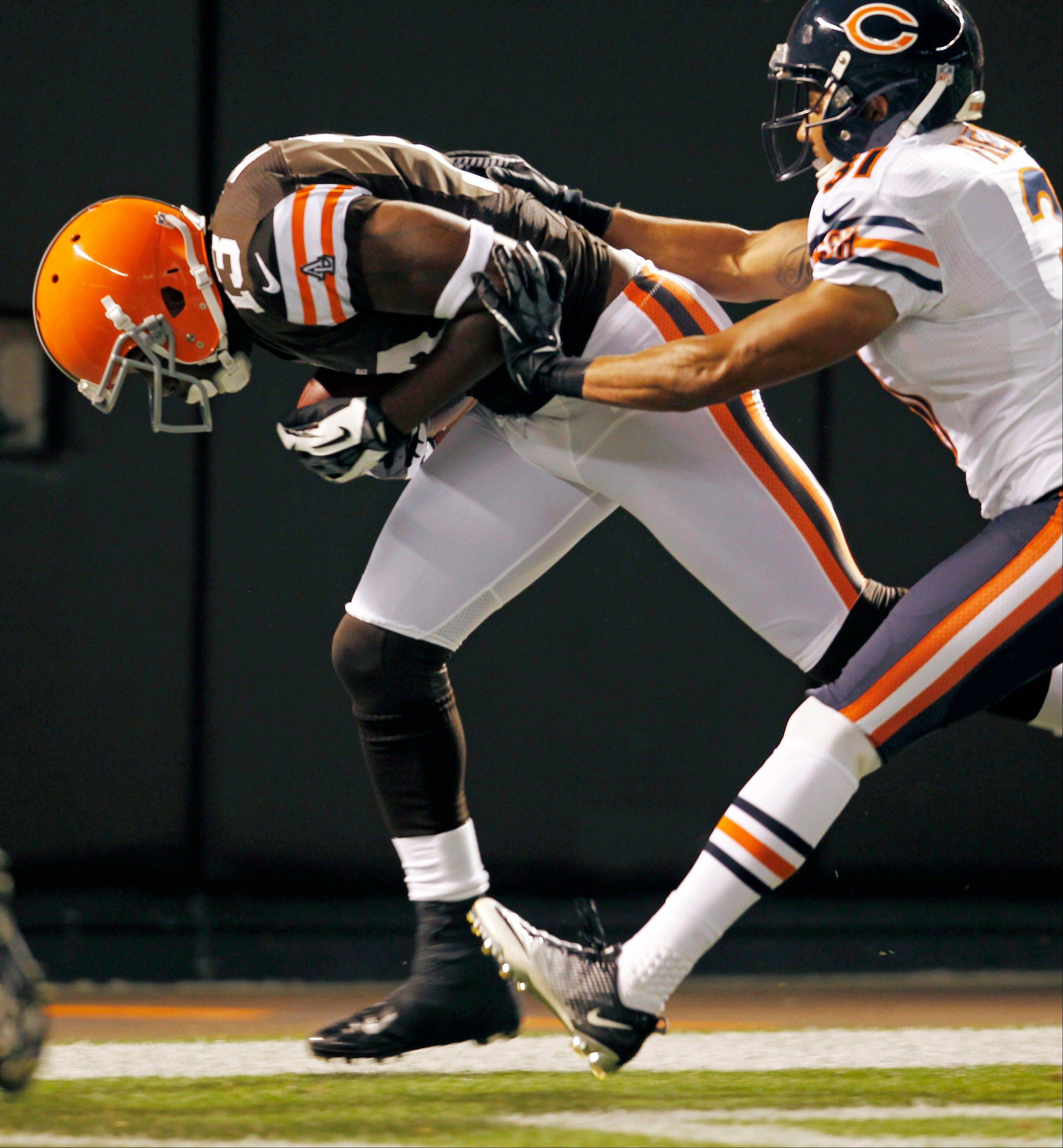Cleveland Browns wide receiver Rod Windsor runs in for a 2-yard touchdown under pressure from Chicago Bears cornerback Isaiah Frey in the second quarter in a preseason NFL football game Thursday, Aug. 30, 2012, in Cleveland.