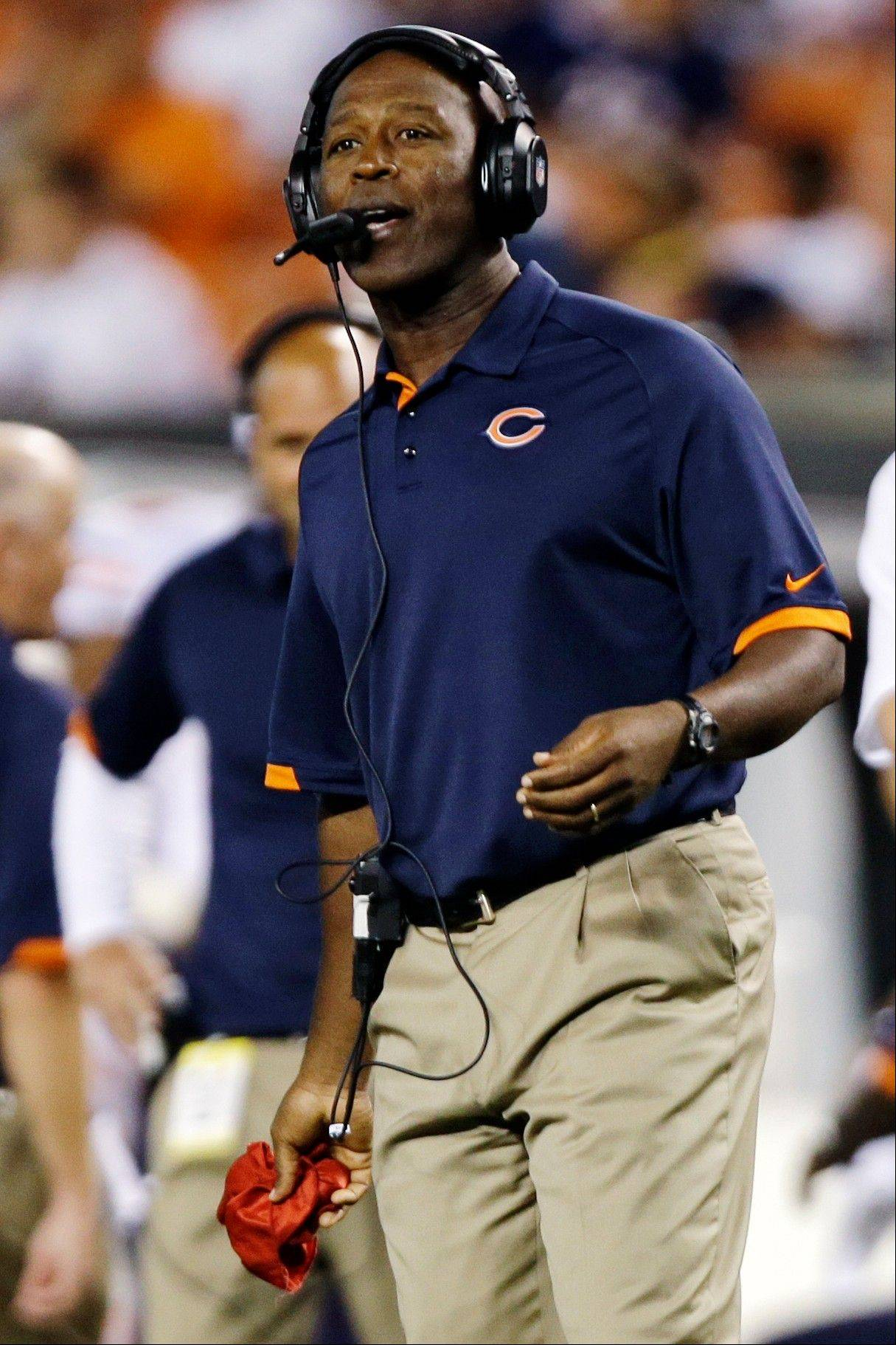 Chicago Bears head coach Lovie Smith challenges a call of an incomplete pass by the Cleveland Browns in the third quarter of a preseason NFL football game, Thursday, Aug. 30, 2012, in Cleveland. The call was reversed after review resulting in an interception return for a touchdown by Bears cornerback Greg McCoy.
