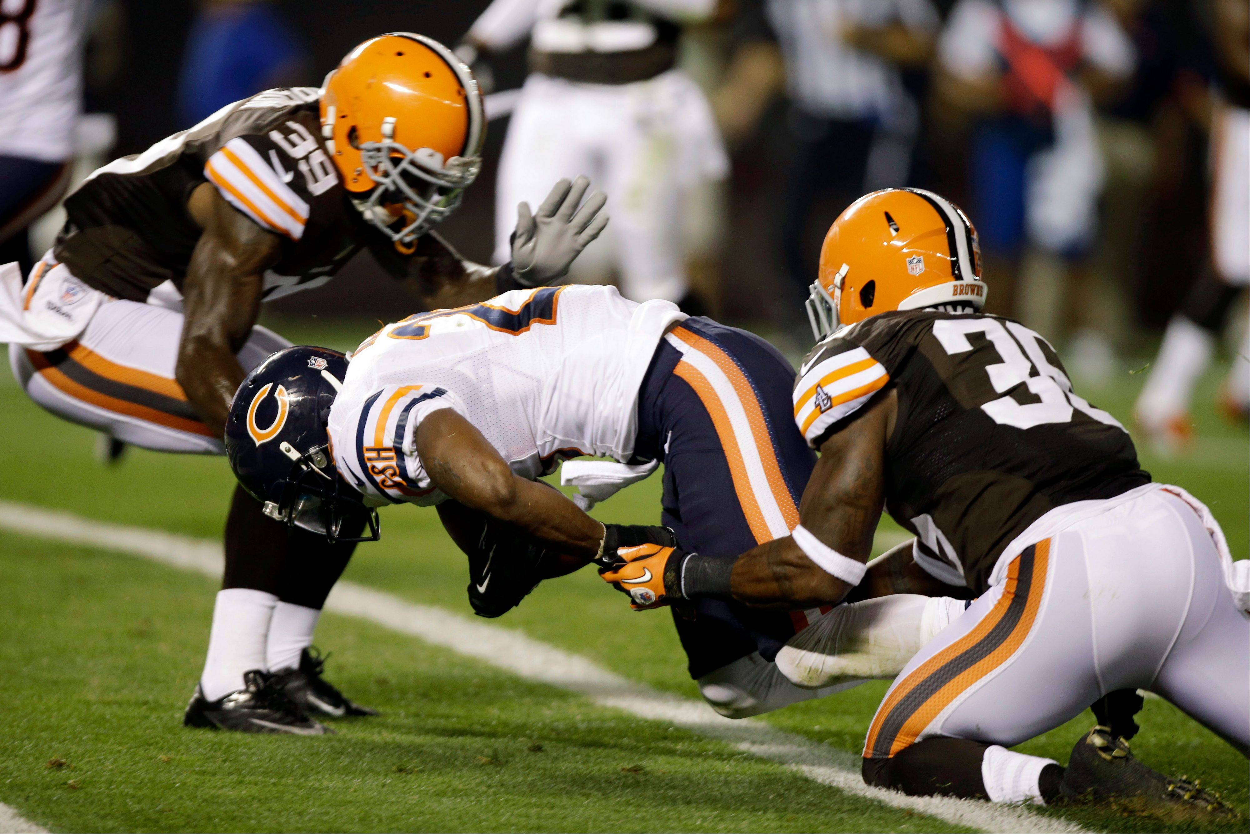Chicago Bears running back Armando Allen enters the end zone for an 11-yard touchdown under pressure from Cleveland Browns' Tashaun Gipson (39) and David Sims during the second quarter of a preseason NFL football game Thursday, Aug. 30, 2012, in Cleveland.