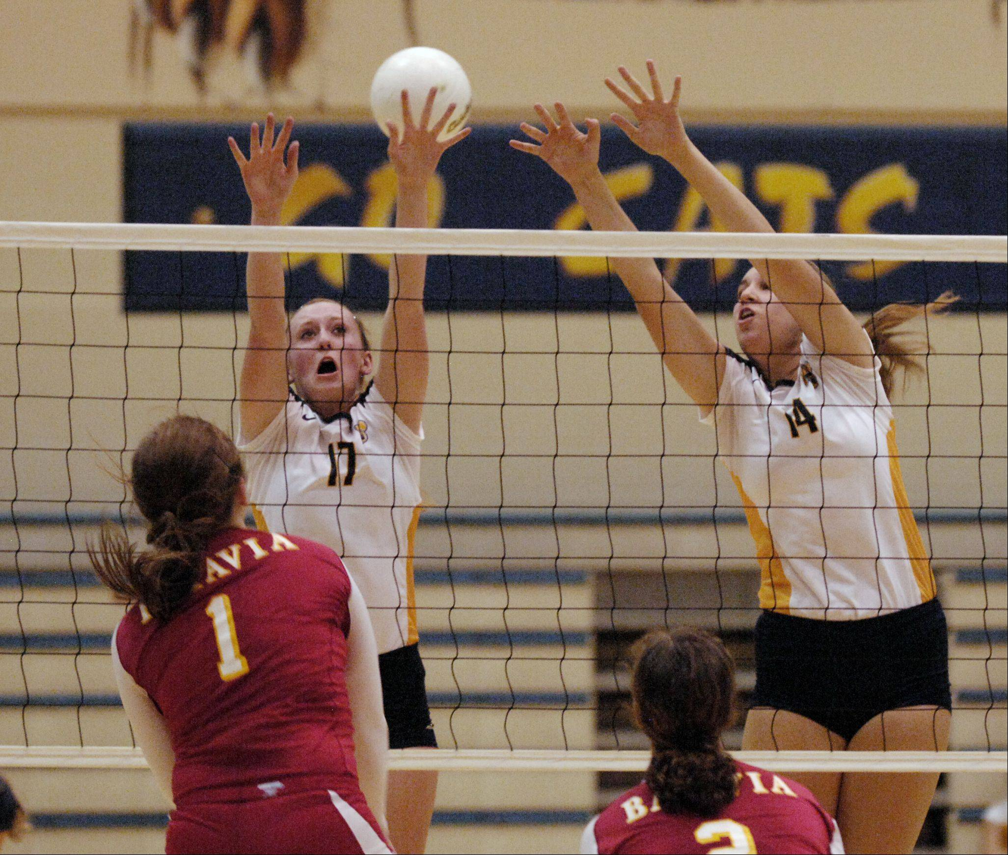 Shea Stanley of Batavia fires the ball past Allie Clarke and Brenna Dunckel of Neuqua Valley during varsity volleyball in Naperville. Batavia won 2-0.