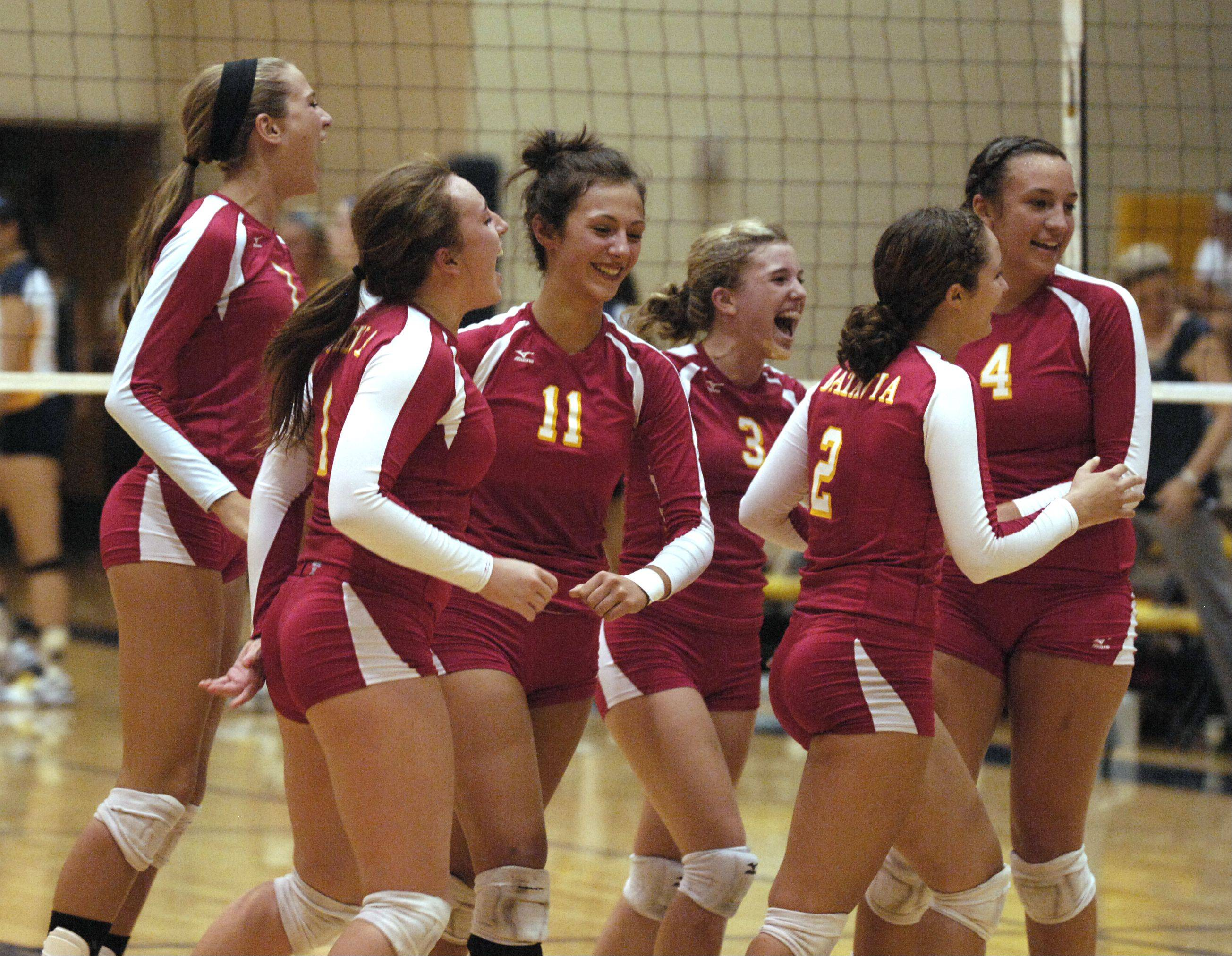 Batavia celebrates defeating Neuqua Valley 2-0 during girls varsity volleyball in Naperville.